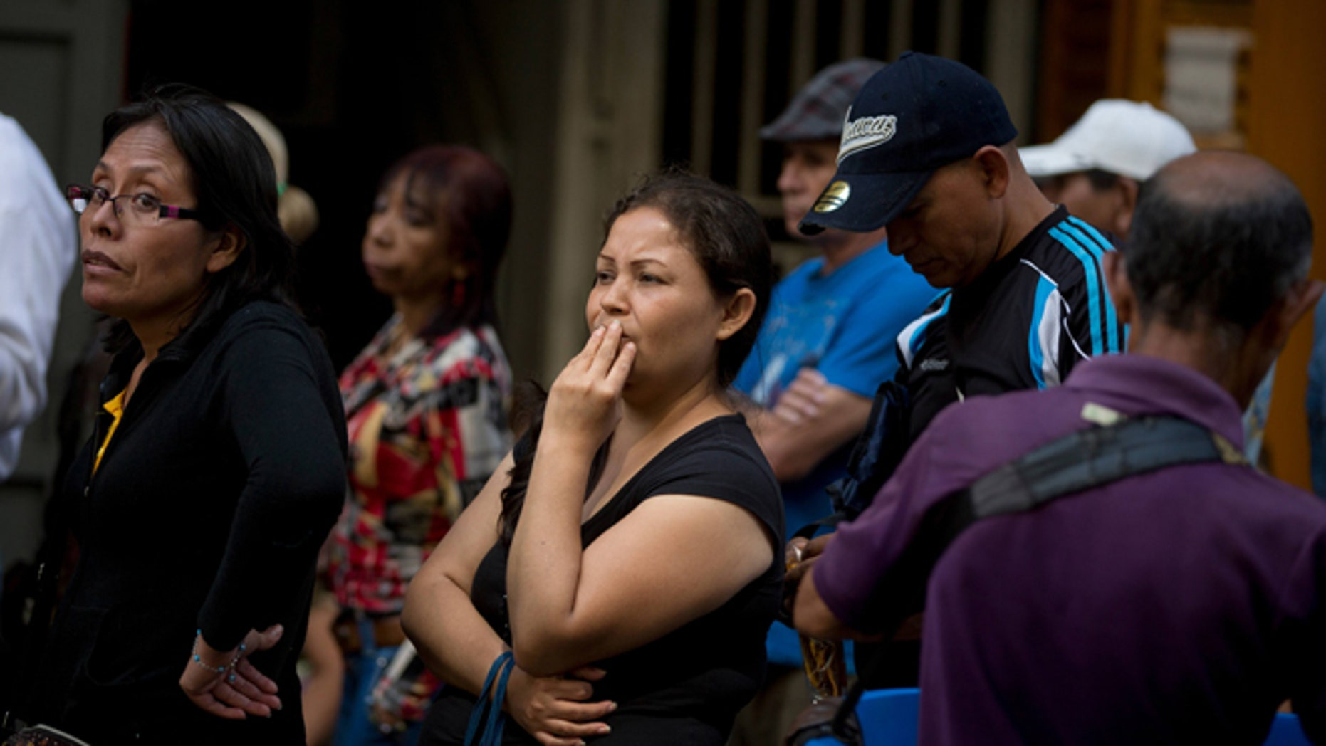 People wait in a line outside a supermarket in Caracas, Venezuela, to buy price regulated toilet paper made available for sale by the government, Friday, Jan. 22, 2016. In a note published Friday, the International Monetary Fund Western Hemisphere Director Alejandro Werner said inflation would more than double in the economically struggling South American country in 2016, reaching 720 percent. (AP Photo/Fernando Llano)
