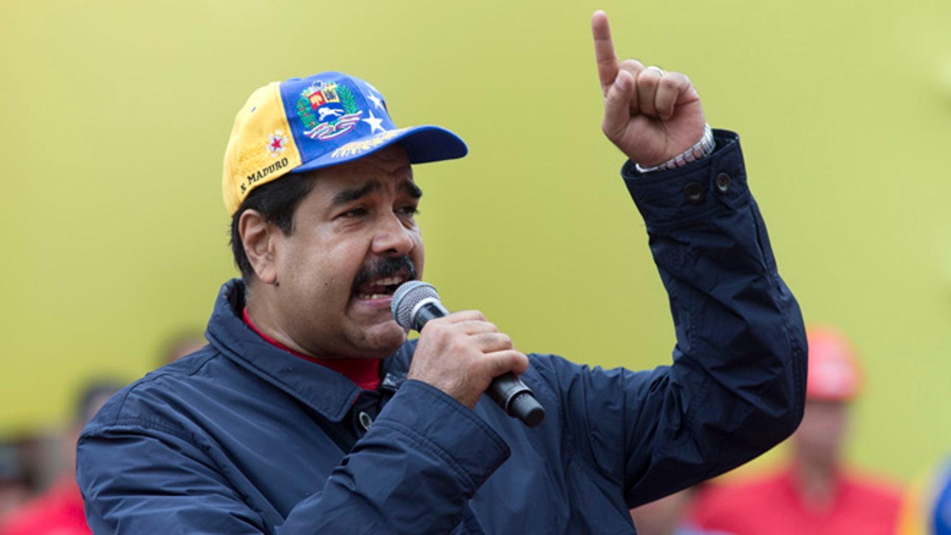 Venezuela's President Nicolas Maduro speaks during a May Day march in Caracas, Venezuela, Sunday, May 1, 2016.