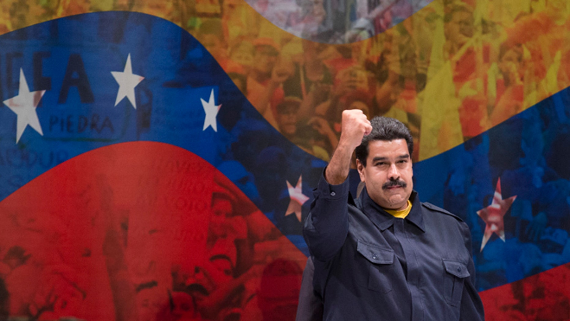 Nicolás Maduro, President of Venezuela, gestures to the crowd before he speaks at Hostos Community College as the United Nations General Assembly convenes, Tuesday, Sept. 23, 2014, in the Bronx borough of New York. (AP Photo/John Minchillo)