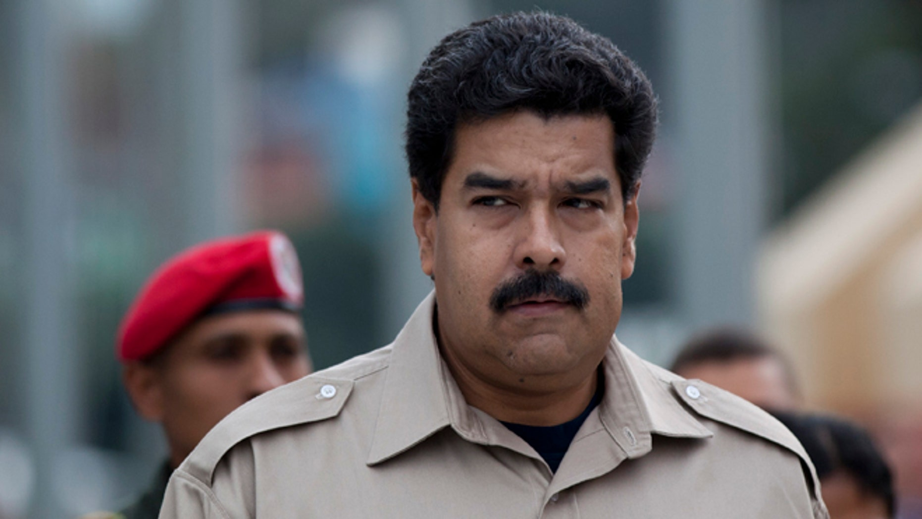 President Nicolas Maduro arrives at the Military Museum to visit the tomb of the late President Hugo Chavez in Caracas, Venezuela, Tuesday, Nov. 5, 2013. Maduro's decree establishing Dec. 8 as a public holiday in honor of Chavez was announced Tuesday. The holiday will commemorate Chavez's final public appearance, when the cancer stricken leader anointed Maduro as his successor. (AP Photo/Ariana Cubillos)
