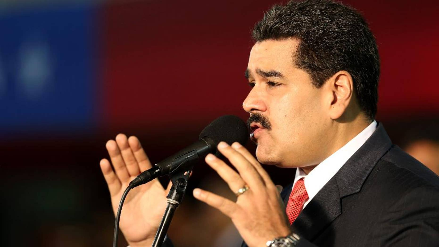 Venezuela's President Nicolas Maduro, delivers his speech during the new military chief's swearing-in ceremony at the Fort Tiuna military base in Caracas, Venezuela, Monday, Oct. 27, 2014. (AP Photo/Ariana Cubillos)