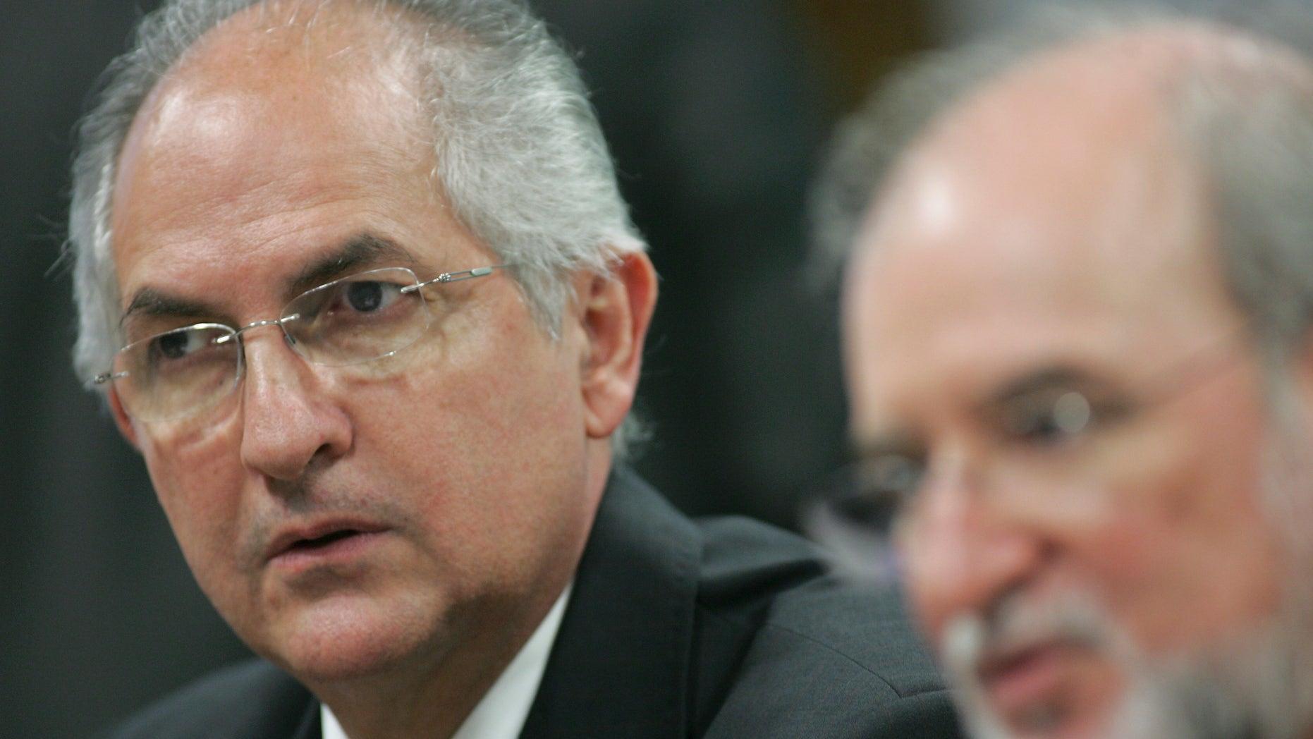 Caracas Mayor Antonio Ledezma, left, attends a meeting in senate chambers, in Brasilia, Brazil.(AP Photo)