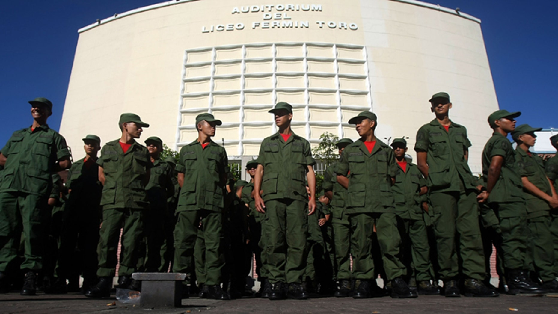Soldiers line up at a polling station before casting their ballots during a referendum on changes to the Constitution proposed by Venezuelan President Hugo Chavez December 2, 2007 in Caracas, Venezuela. (Photo by Mario Tama/Getty Images)