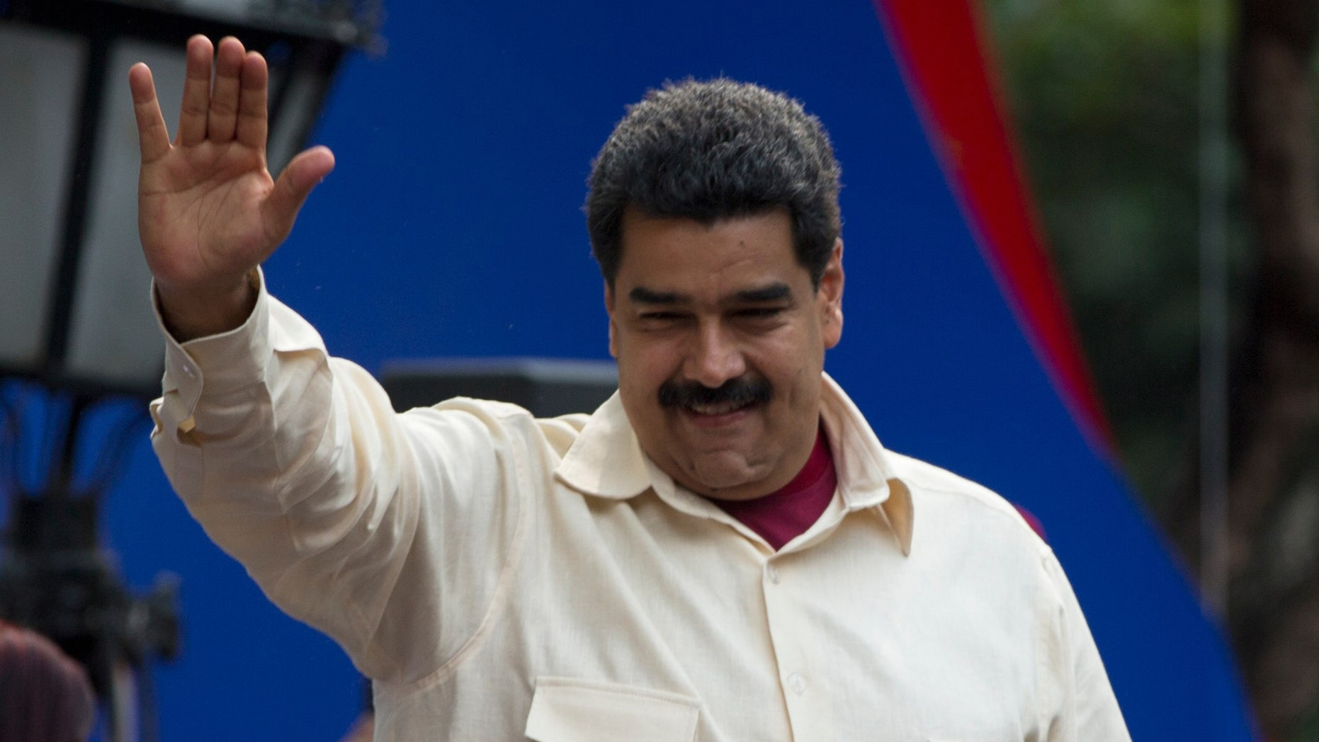 File-This April 19, 2016, file photo shows Venezuelaâs President Nicolas Maduro greeting supporters upon his arrival to Bolivar Square to celebrate the 206th anniversary of the call for independence from Spain, in Caracas, Venezuela.  The president is ordering a 30 percent increase in the minimum wage, the latest move by the socialist government to grapple with high inflation and economic stagnation. The boost announced Saturday, April 30, 2016, by Maduro comes after a 25 percent increase on March 1. (AP Photo/Fernando Llano, File)