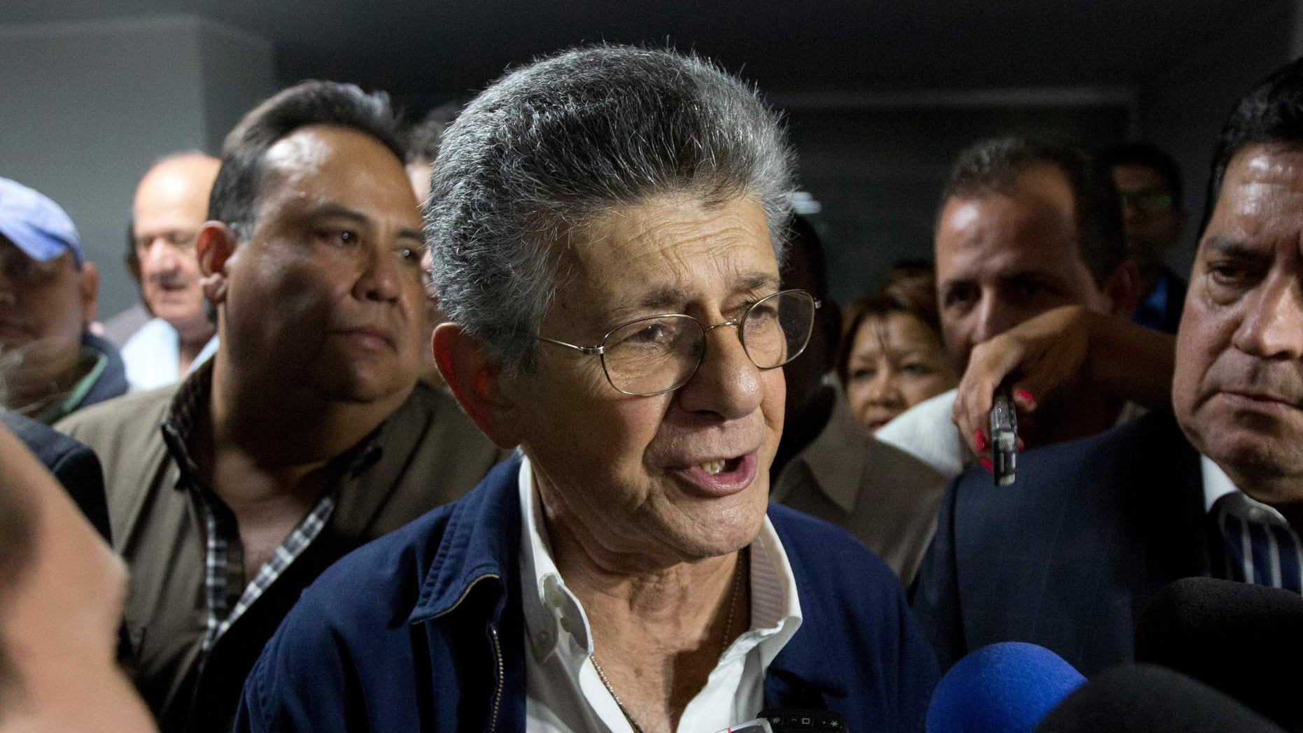Congressmen Henry Ramos Allup speaks with media after he was elected as the Venezuela National Assembly's President in Caracas, Venezuela, Sunday, Jan. 3, 2016. Newly-elected opposition lawmakers voted in Ramos as National Assembly president Sunday. (AP Photo/Fernando Llano)