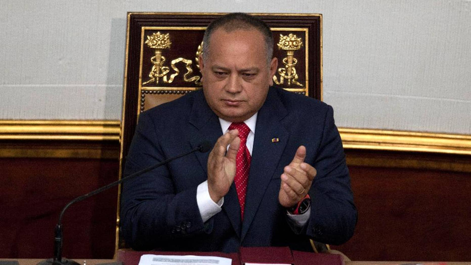 FILE - In this Jan. 5, 2013 file photo, National Assembly President Diosdado Cabello applauds before addressing the National Assembly in Caracas, Venezuela. Cabello said on Wednesday, May 13, 2015 he is asking courts to bar news executives from leaving the country while he's suing them for alleged defamation. (AP Photo/Ariana Cubillos, File)