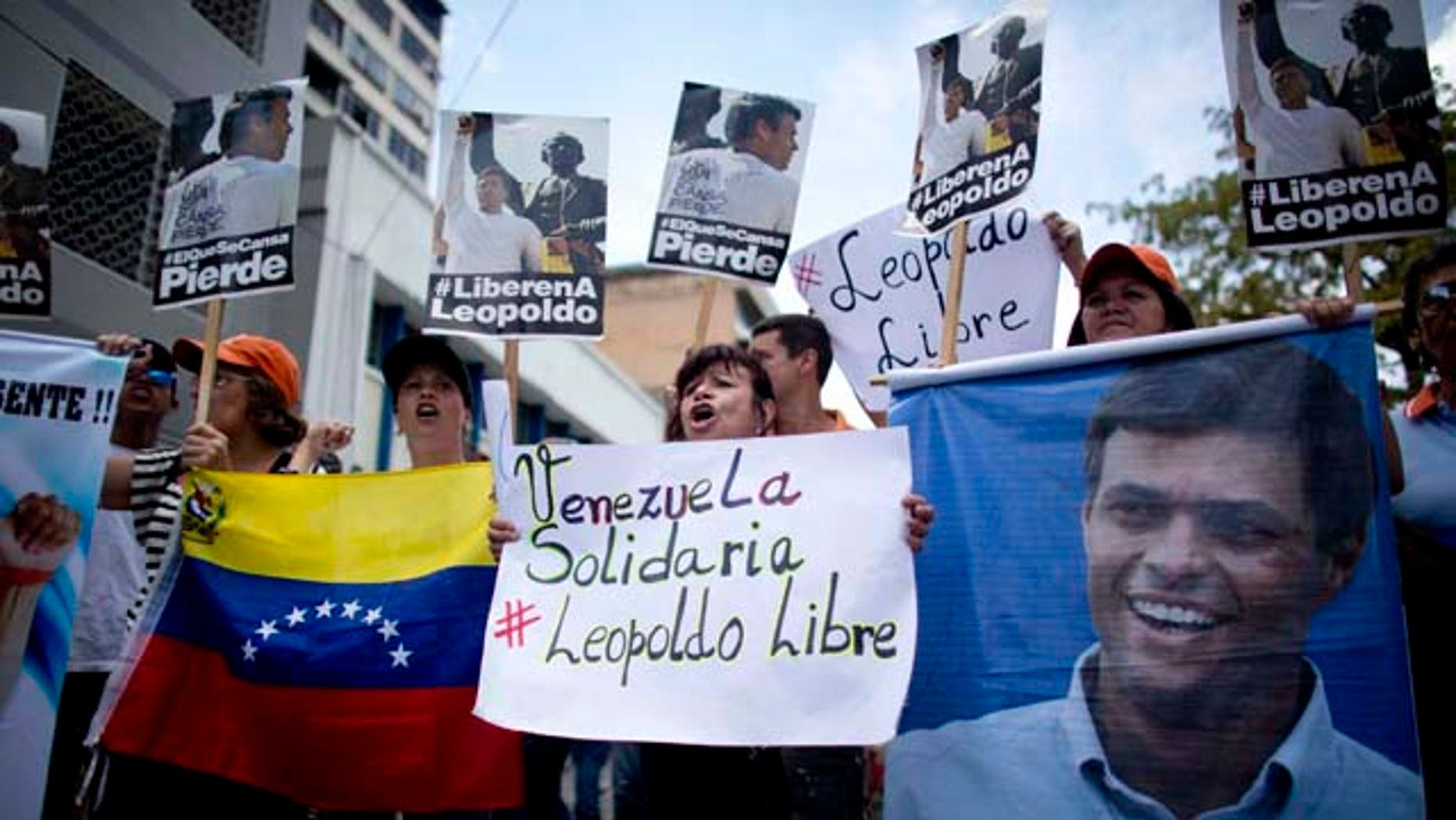 Sept. 10, 2015: People chant slogans in support of jailed opposition leader Leopoldo Lopez, outside the courthouse in Caracas, Venezuela. (AP Photo/Ariana Cubillos)