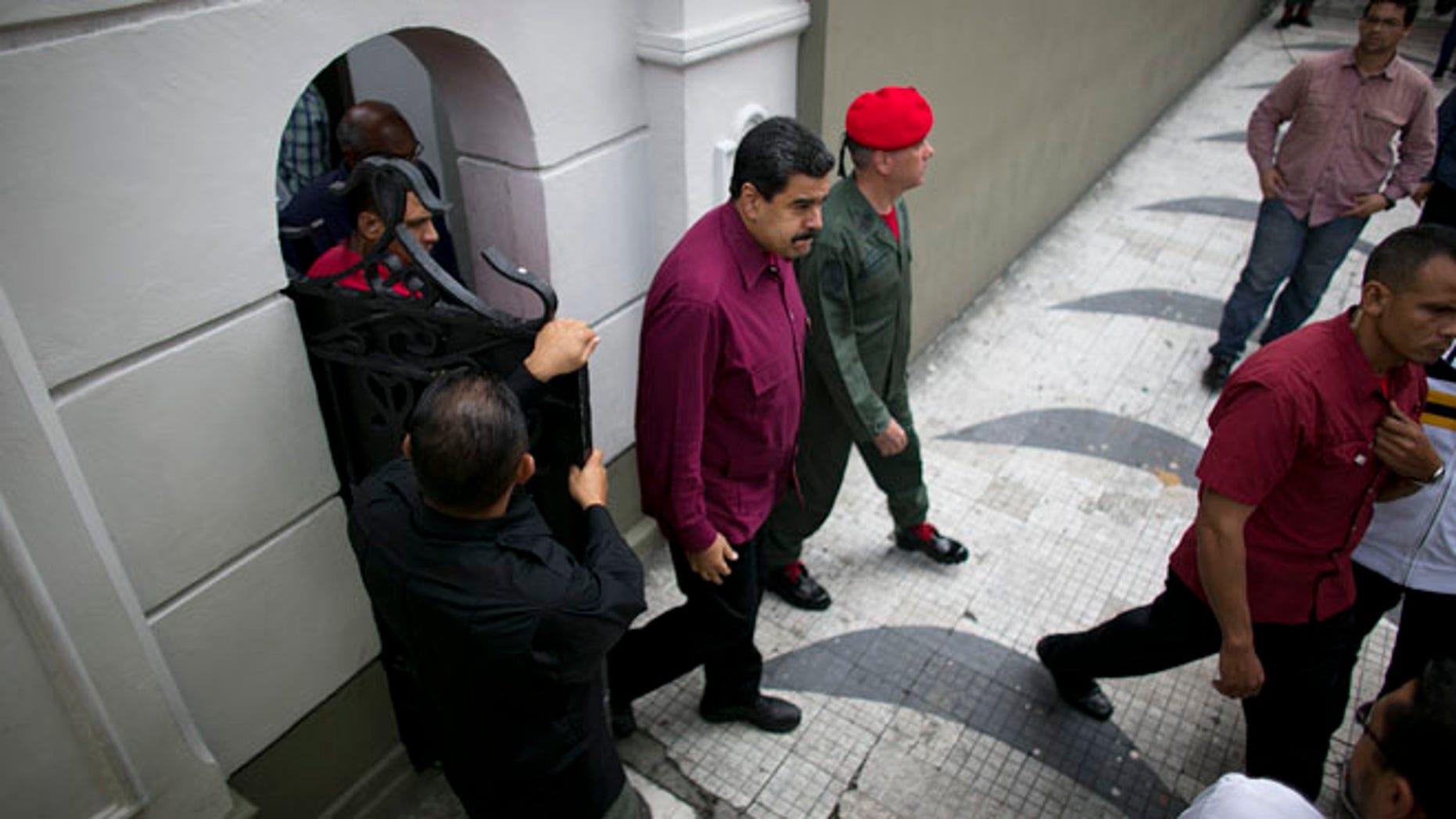 President Maduro exits an area of Miraflores presidential palace in Caracas, Venezuela, Friday, Oct. 28, 2016.