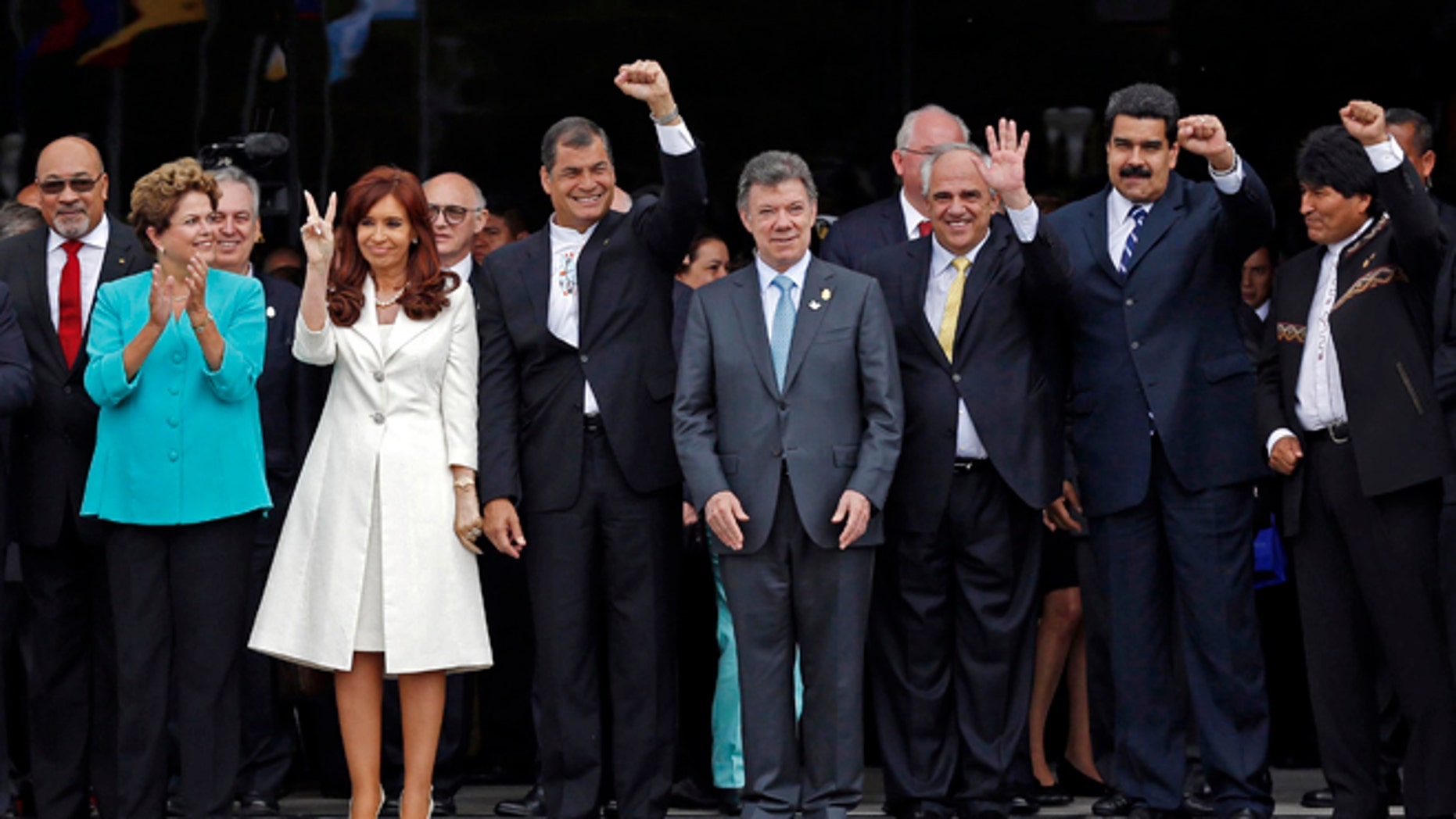 FILE - In this Dec. 5, 2014 file photo, UNASUR leaders pose for a group photo at the inauguration of the new UNASUR headquarters building in Quito, Ecuador. From left to right are Suriname's President Desi Bouterse, Brazil's President Dilma Rousseff, Argentina's President Cristina Fernandez, Ecuador's President Rafael Correa, Colombia's President Juan Manuel Santos, UNASUR General Secretary and former Colombian President  Ernesto Samper, Venezuela's President Nicolas Maduro, and Bolivia's President Evo Morales. The South American regional bloc did attempt to mediate between the Venezuelan government and the opposition last year. But that effort fell through, and observers see those leaders as loath to try again. (AP Photo/Dolores Ochoa, File)