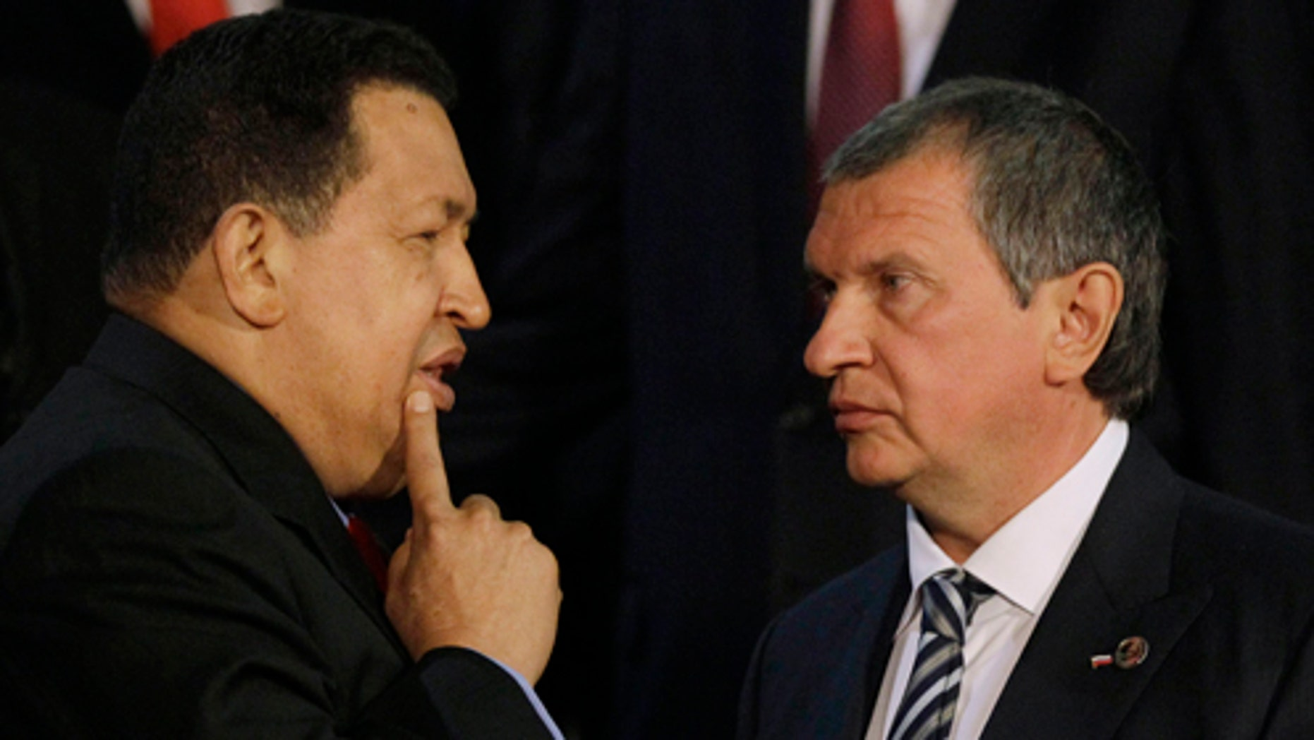 Venezuelaâs President Hugo Chavez, left, speaks with Igor Sechin, the CEO of Russia's state-controlled Rosneft oil company, after a meeting at Miraflores presidential palace in Caracas, Venezuela, Thursday, Sept. 27, 2012. Chavez has built close ties with Russia, and on Thursday, a joint venture involving state oil company Petroleos de Venezuela SA and a consortium of Russian oil companies began to tap a rich deposit of heavy oil in eastern Venezuela. (AP Photo/Ariana Cubillos)