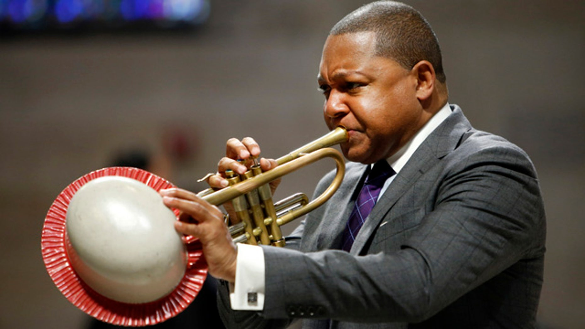 FILE - In this Sept. 20, 2014, file photo, musician Wynton Marsalis performs during a memorial service for actress Ruby Dee at The Riverside Church in New York. (AP Photo/Jason DeCrow, File)