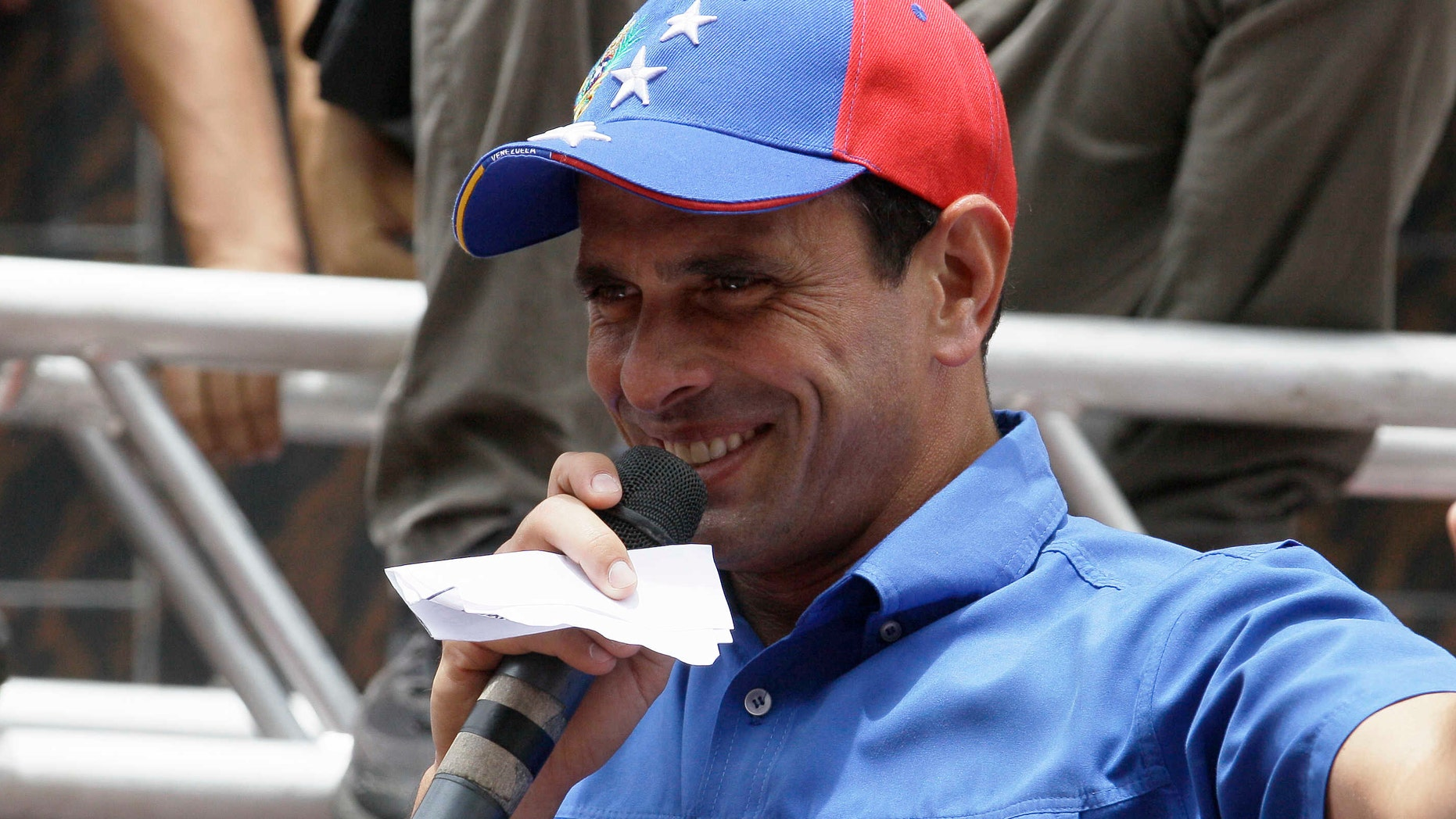 Venezuela's Presidential candidate Henrique Capriles speaks to supporters at a campaign rally in El Junko, near Caracas, Venezuela, Friday, Aug. 3, 2012. Venezuela's presidential election is scheduled for Oct. 7.(AP Photo/Fernando Llano)