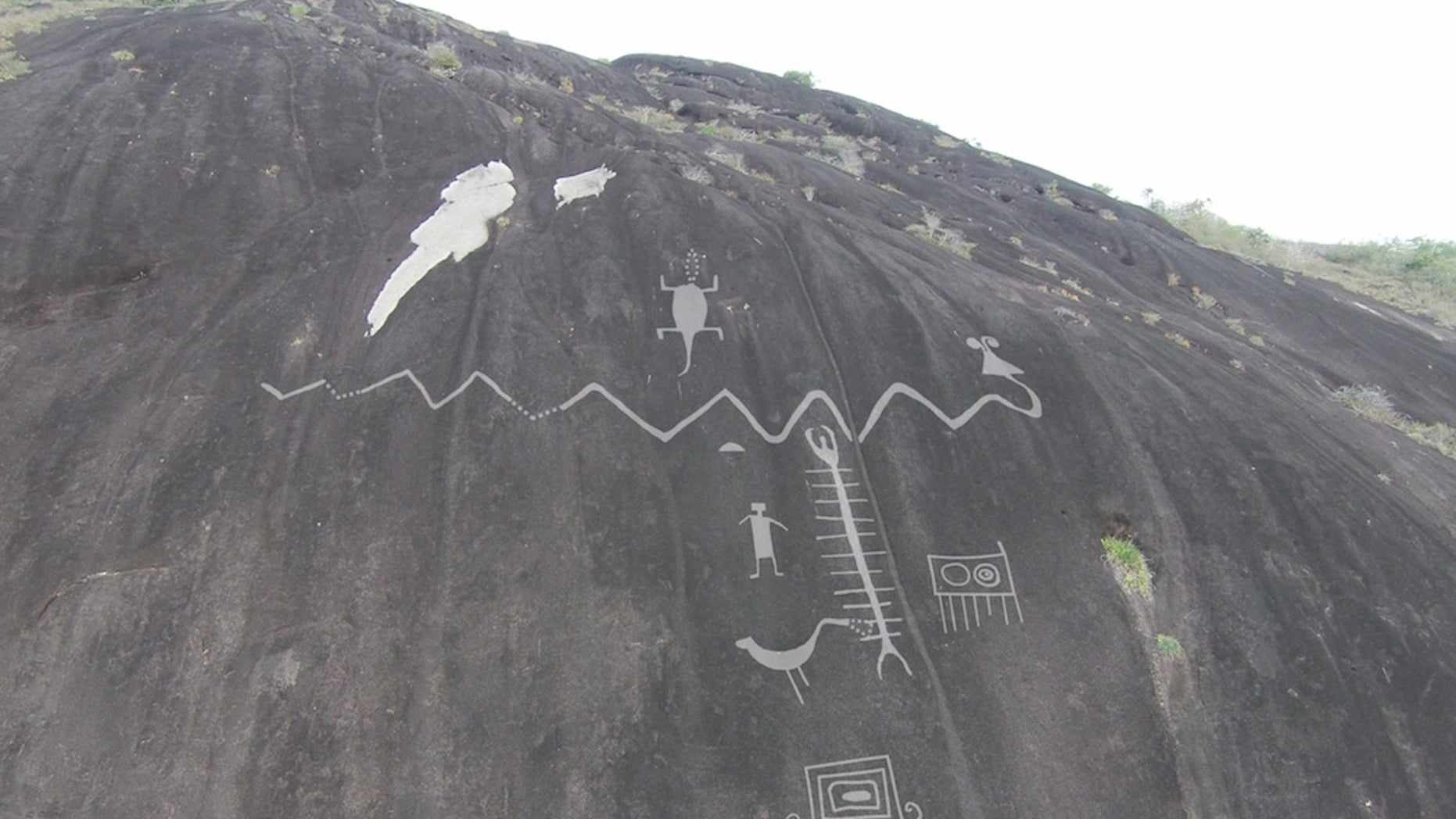 A drone took this photo of rock art high on a mountain. Researchers used digital overlay to highlight the art in this image.