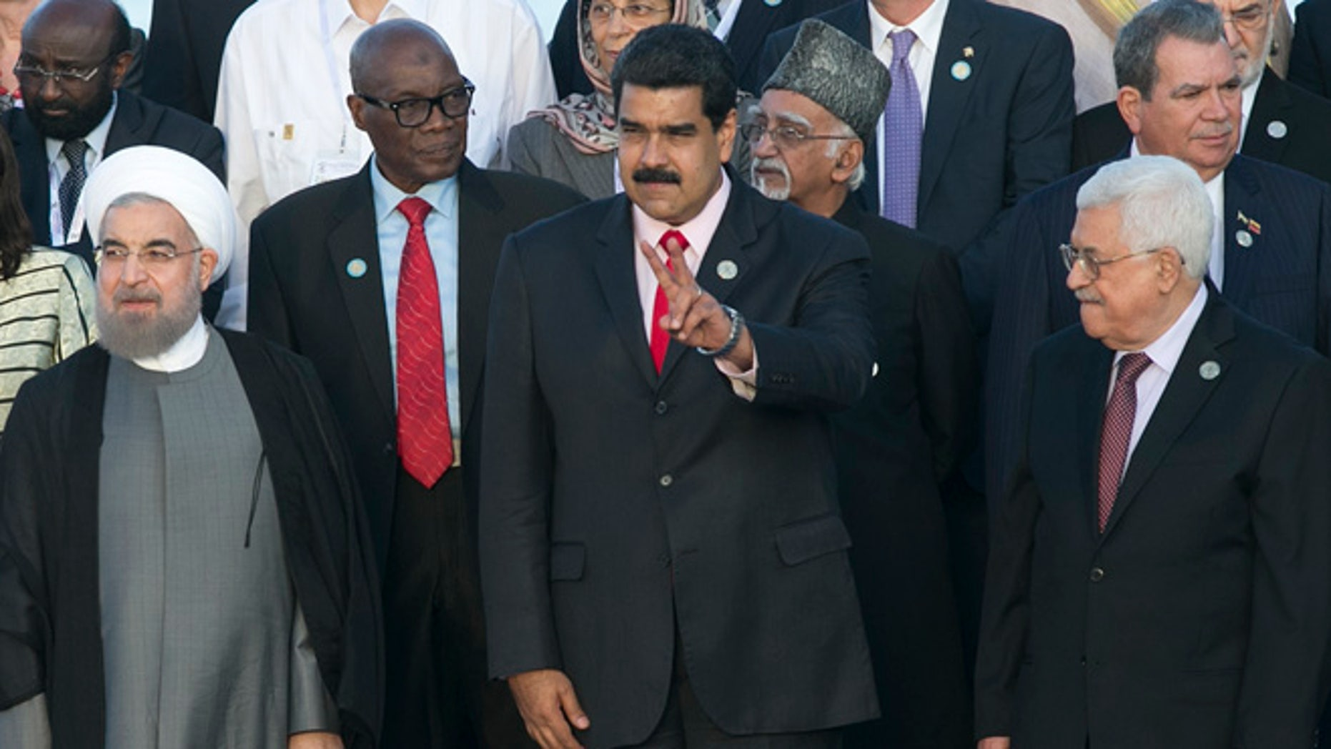 Iran's President Hassan Rouhani, front row, from left, Venezuela's President Nicolas Maduro, and Palestinian President Mahmoud Abbas, gather for an official group photo at the 17th Non-Aligned Movement Summit in Porlamar, on Venezuela's Margarita Island, Saturday, Sept. 17, 2016. (AP Photo/Ariana Cubillos)