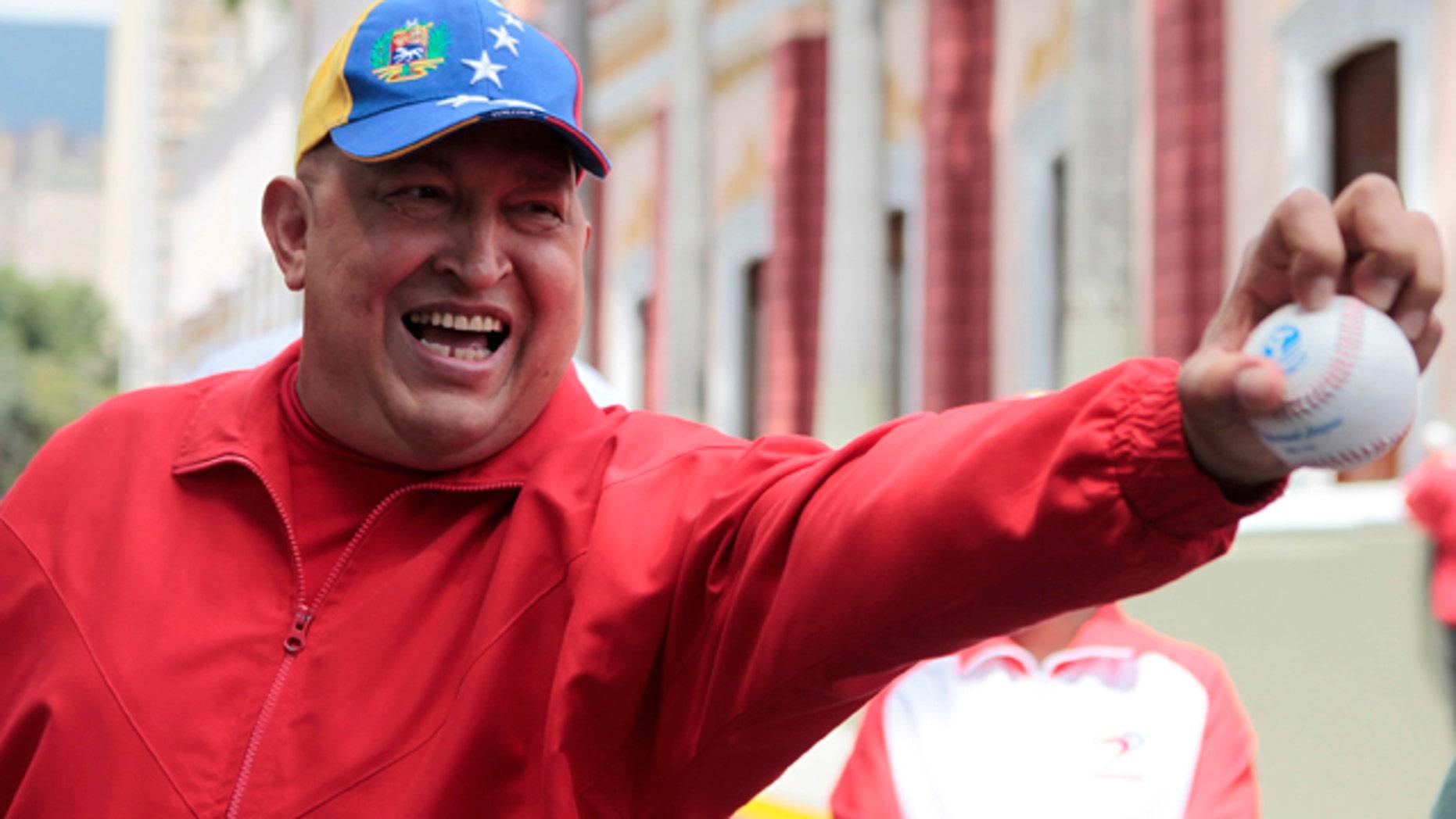 FILE: September 2011: President Hugo Chavez holds out a baseball outside the presidential palace in Caracas, Venezuela.