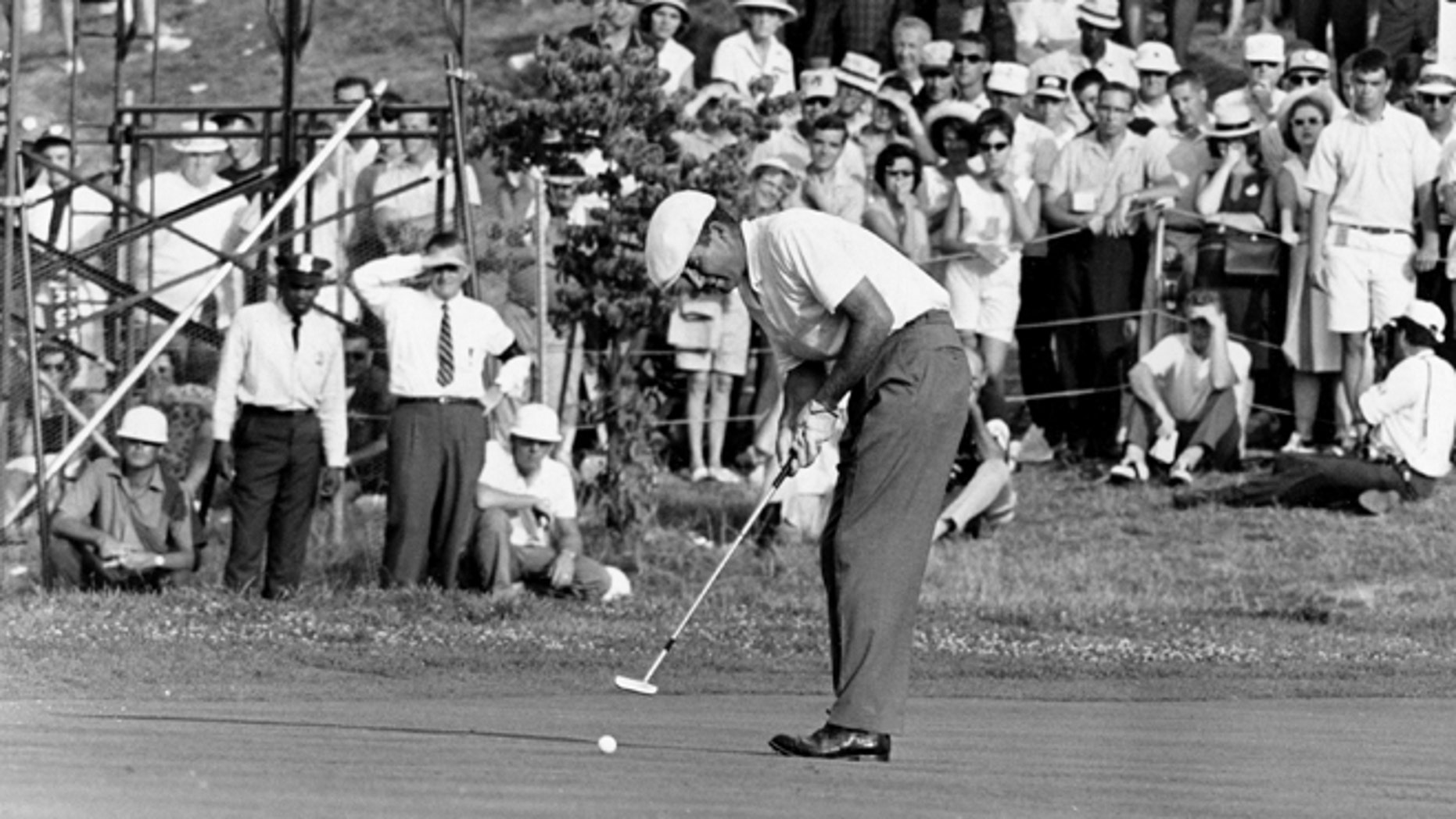 June 20, 1964: This file photo shows Ken Venturi making the final putt on the 18th green during the U.S. Open Golf Championship at Congressional Country Club in Bethesda, Md.