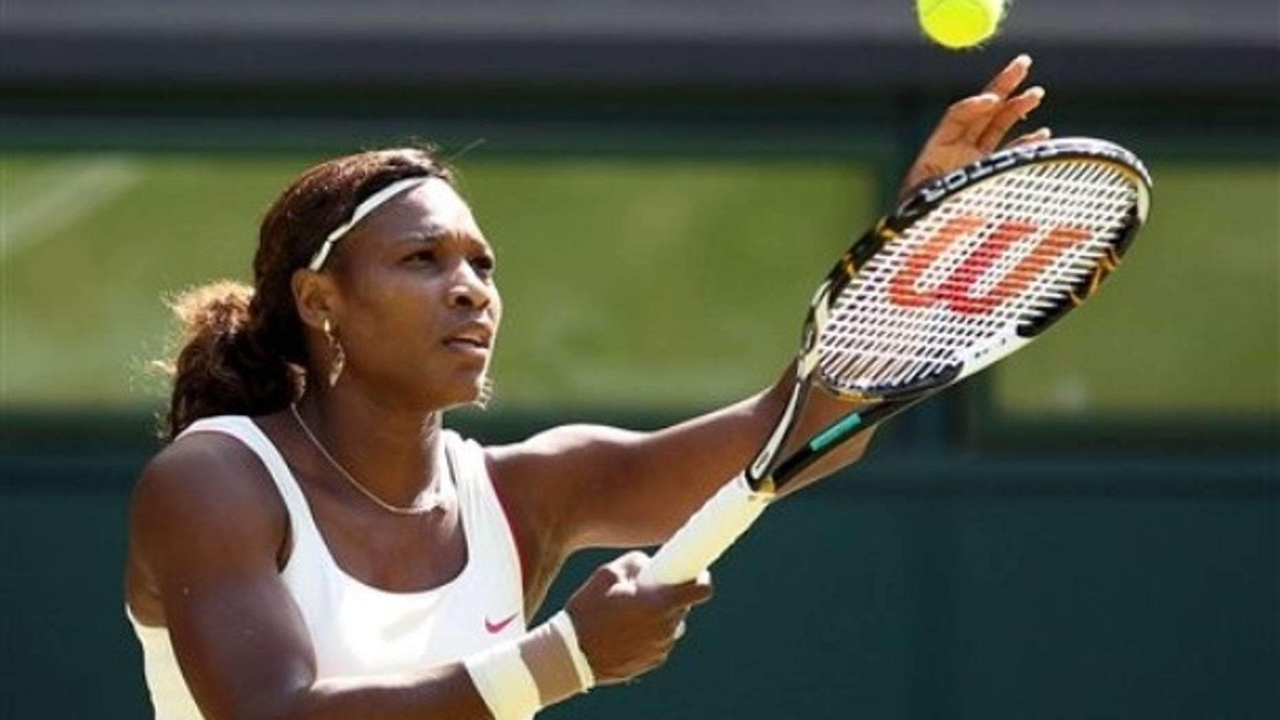 Venus Williams of the United States prepares to serve during her quarterfinal match against China's Li Na at the All England Lawn Tennis Championships at Wimbledon, Tuesday, June 29, 2010. (AP Photo/Anja Niedringhaus)