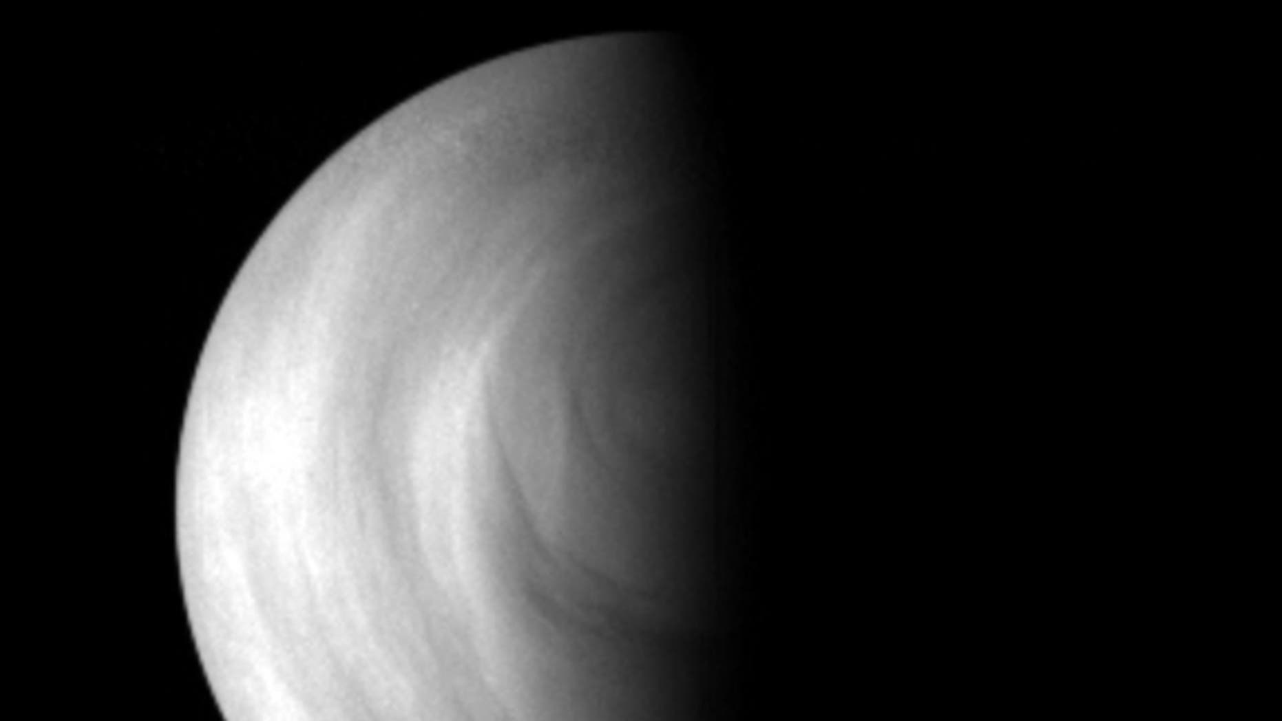 The terminator of Venus (the line between day and night) as seen by the Venus Express spacecraft in May 2006.
