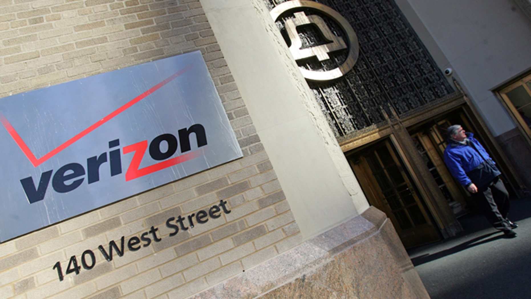 FILE- In this Dec. 8, 2005, file photo, a man walks out the Verizon's new corporate headquarters(AP Photo/Dima Gavrysh, File)
