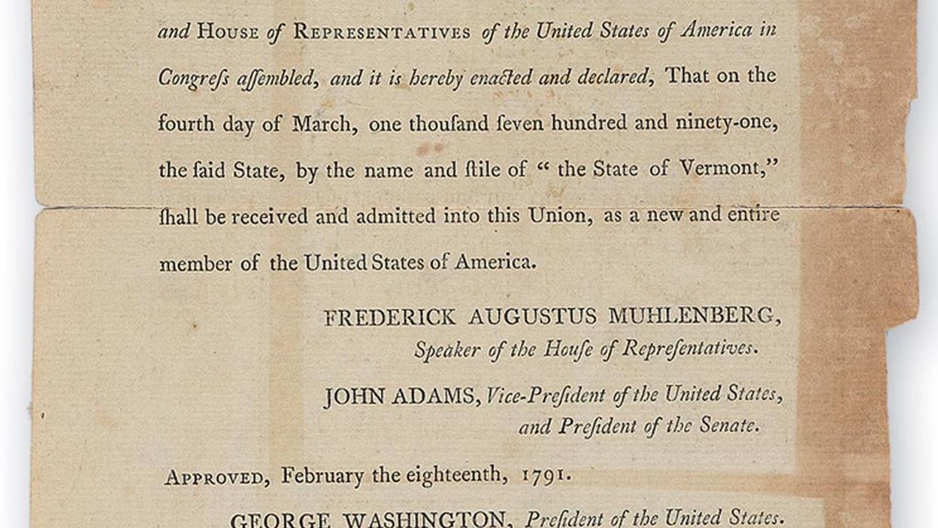This 2014 photo released by Swann Auction Galleries of New York shows a portion of a document signed by Thomas Jefferson in 1791 declaring Vermont as the 14th of the United States. The document is set to be auctioned with others signed by Ethan Allen, a founder of the state, on Thursday, Nov. 20, 2014.  (AP Photo/Swann Auction Galleries)