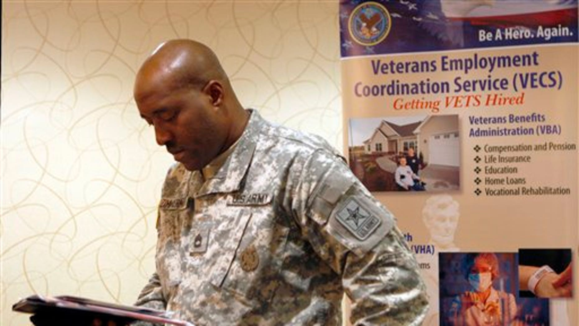 May 3: Army Sgt.1st Class Lonell Zimmerman, of Vineland, N.J., looks over some papers as he attends a job fair aimed at helping military and former military members transition to civilian jobs, in Cherry Hill, N.J.