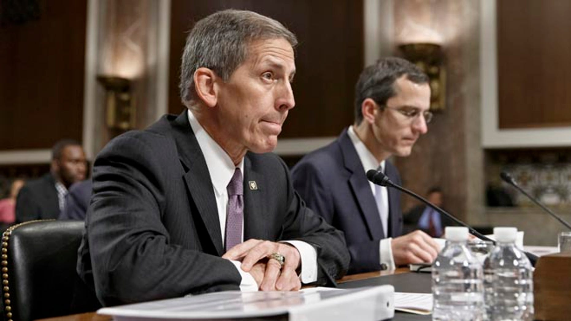 Veterans Affairs acting Secretary Sloan Gibson testifies on Capitol Hill in Washington, Wednesday, July 16, 2014, before the Senate Veterans' Affairs Committee hearing on the state of VA health care in the wake of revelations of neglect and delayed medical visits. He is accompanied by Assistant Deputy Undersecretary For Health For Administrative Operations Philip Matkowsky.
