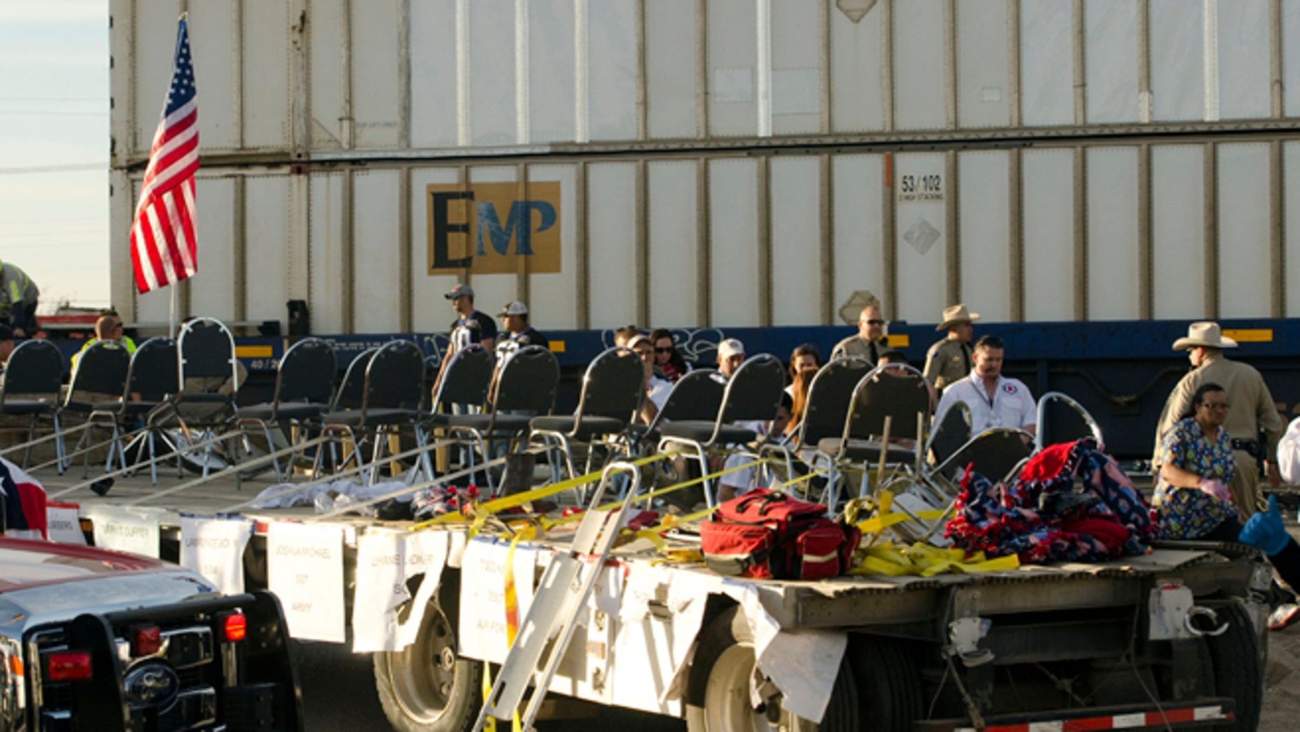 Nov. 15, 2012: In this file photo, authorities respond to an accident involving a trailer carrying wounded veterans that was struck by a train during a parade in Midland, Texas.