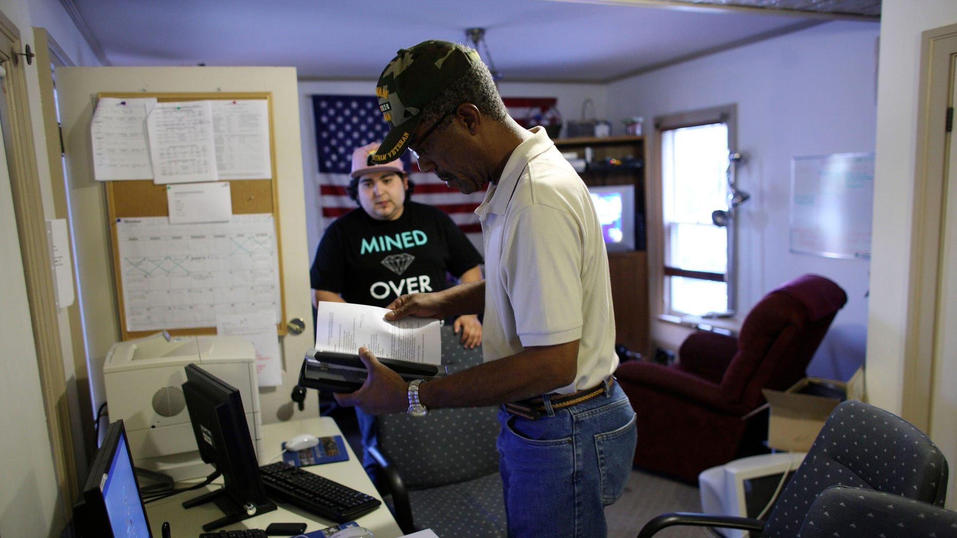FILE: Undated: A military veteran gets help with his resume from an Iraq war veteran at the Midwest Shelter for Homeless Veterans in Wheaton, Illinois.