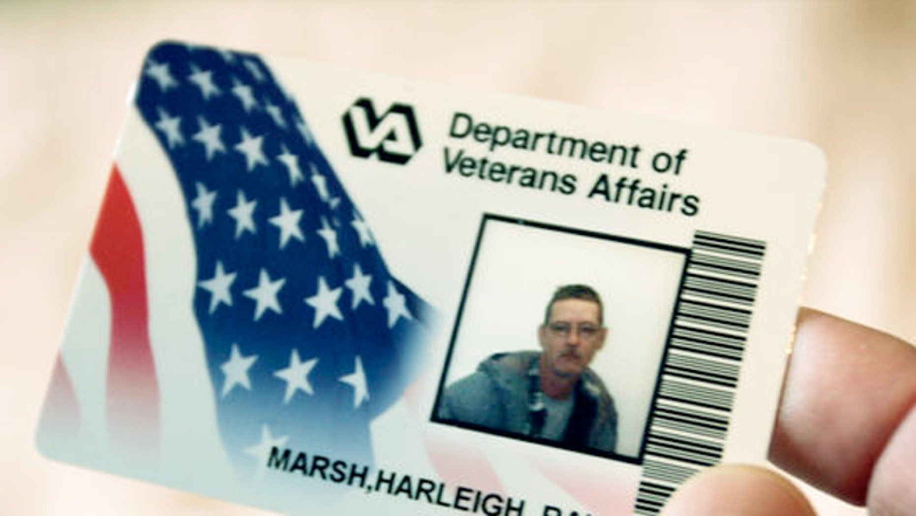 FILE: 2005: A  veteran displays his VA Card, one of the few items he keeps while homeless, in his shared room at a West Virginia shelter.