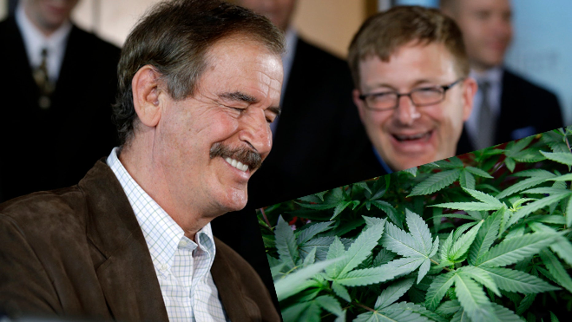 Former Mexican President Vicente Fox, left, speaks as Jamen Shively, CEO of Diego Pellicer, looks on during a news conference Thursday, May 30, 2013, in Seattle. (AP Photo/Elaine Thompson)