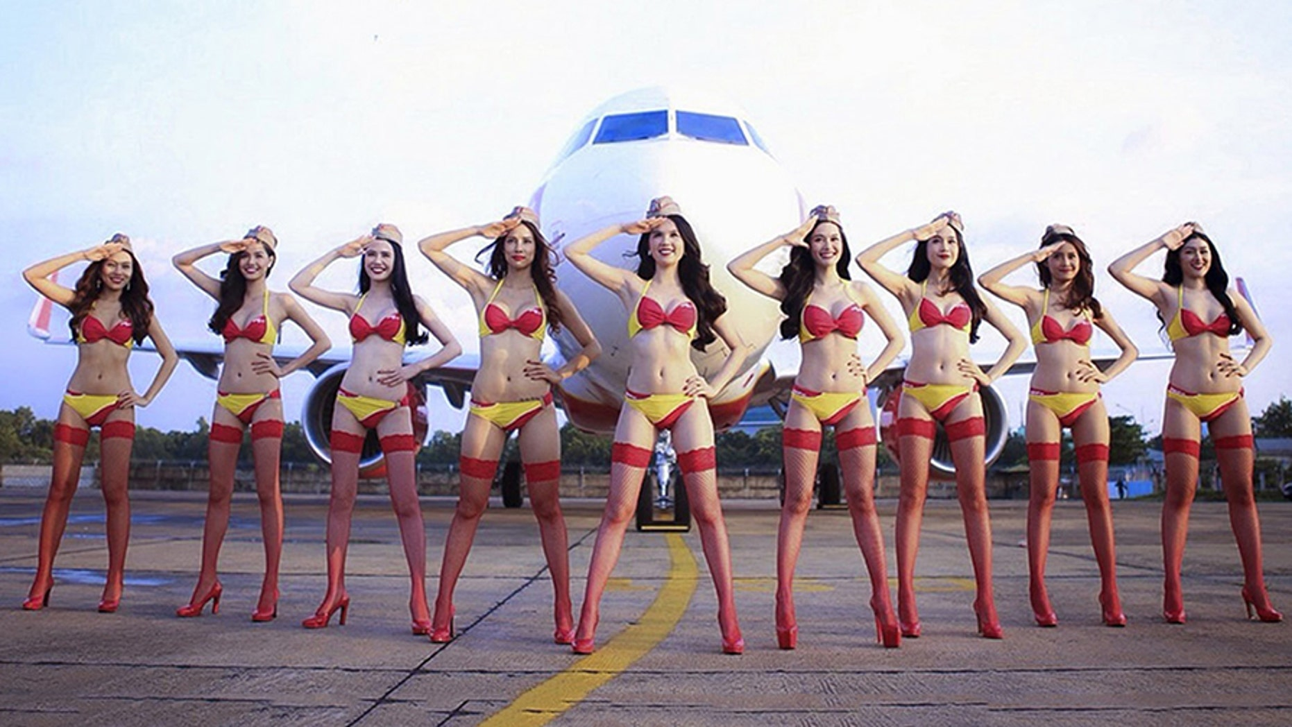 Models dressed in scantily-clad clothing put on an in-flight performance for Vietnam's under-23 soccer team Sunday, Jan. 28, 2018.