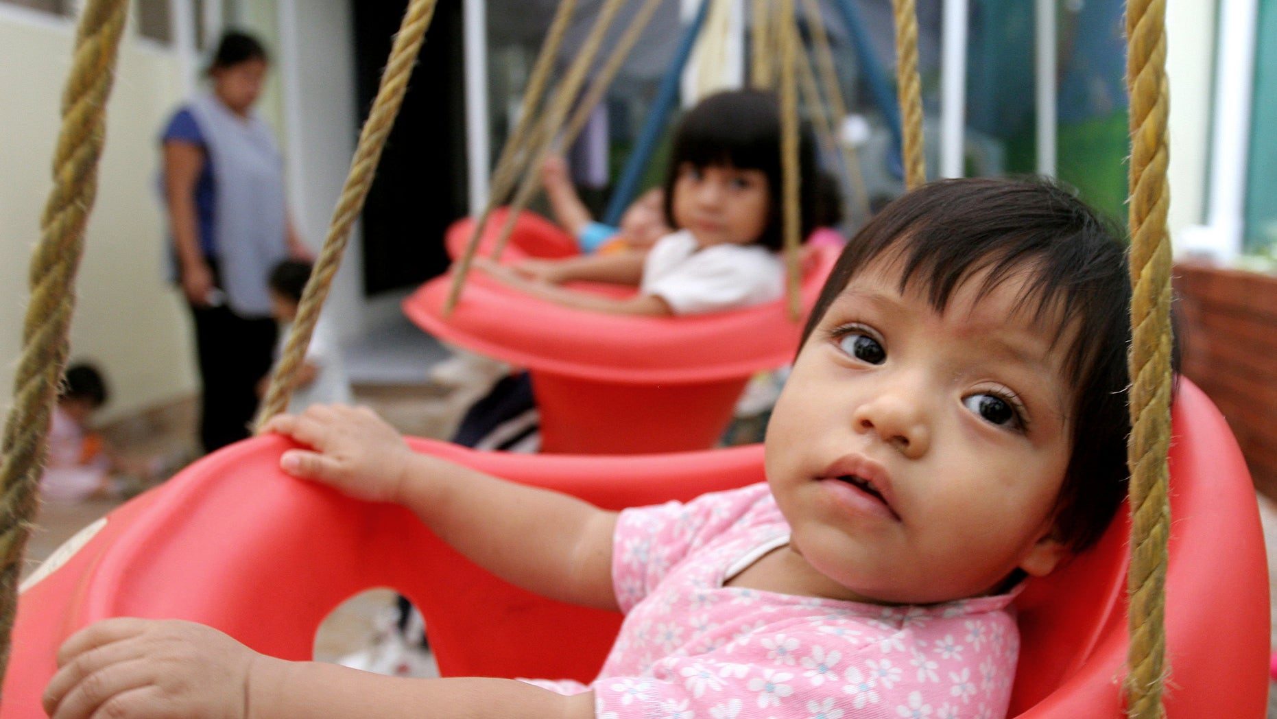In this June 12, 2006 file photo, children waiting for adoptions are seen in a house held by a lawyer specialized in adoptions in Guatemala City, Guatemala. The number of international adoptions has plummeted to its lowest point in 15 years, a steep decline attributed largely to crackdowns against baby-selling, a sputtering world economy and efforts by countries to place more children with domestic families. (AP Photo/Alexandre Meneghini, File)