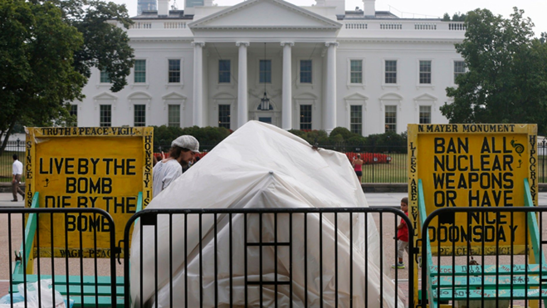 Sept. 12, 2013: The protest shelter for peace protestor Concepcion Picciotto, who holds a constant peace vigil in Lafayette Park across from the White House in Washington, is reassembled after her belongings were returned by Park Police after they were seized by Park Police.