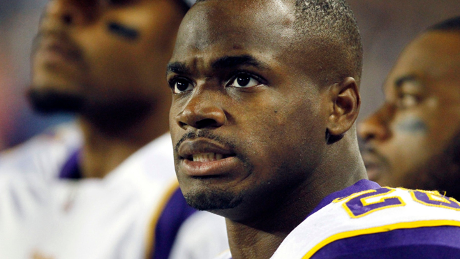 Oct. 16, 2011: In this file photo, Minnesota Vikings running back Adrian Peterson watches from the sidelines during the first half of an NFL football game in Chicago. (AP)