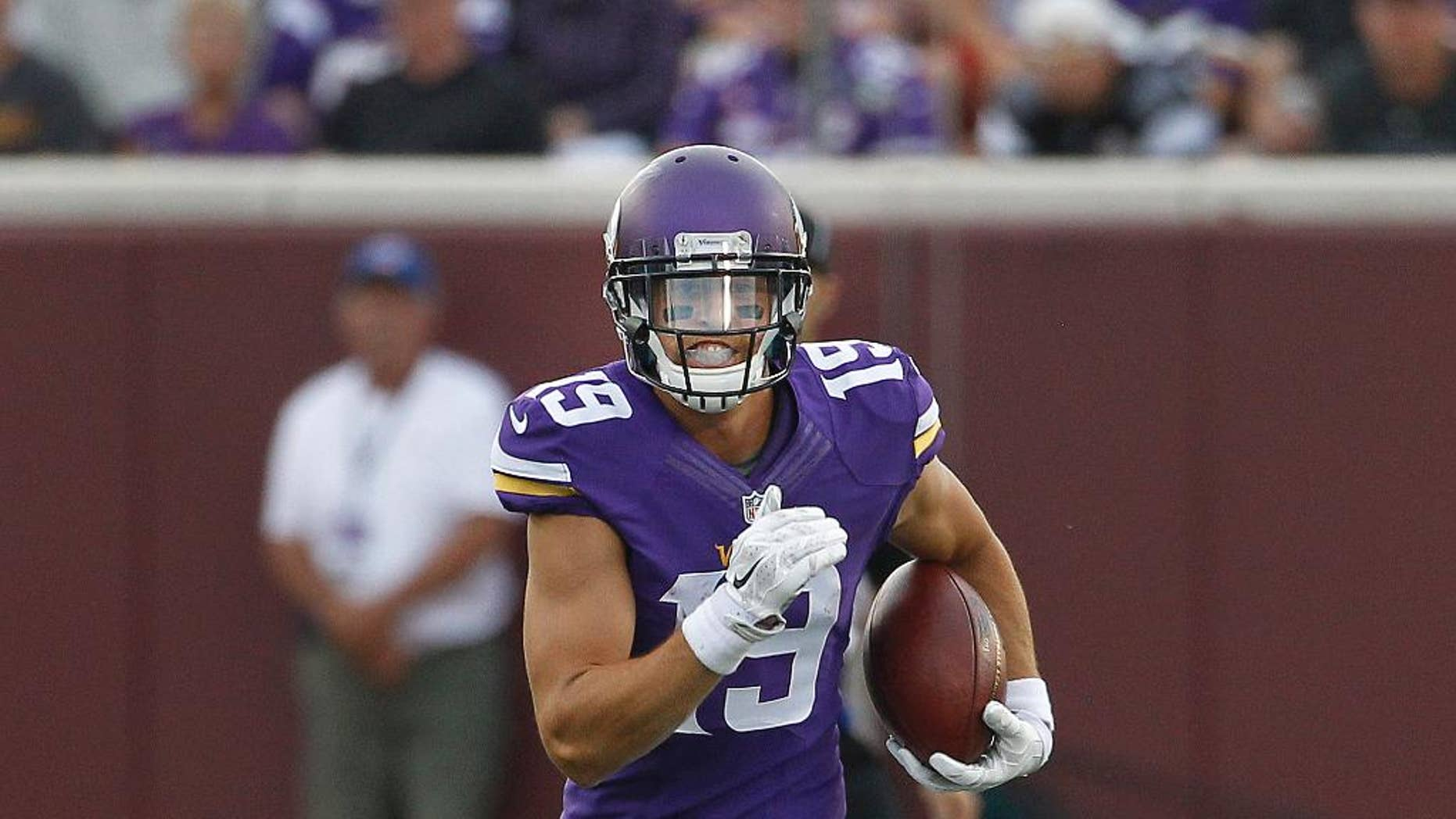 FILE - In this Aug. 8, 2014, file photo, Minnesota Vikings wide receiver Adam Thielen (19) runs the ball against the Oakland Raiders in the first half of a preseason NFL football game at TCF Bank Stadium in Minneapolis. After making a strong enough impression as an undrafted rookie last year to land a spot on the practice squad with the Vikings, Thielen has put himself in position to make the active roster this season.  (AP Photo/Ann Heisenfelt, File)