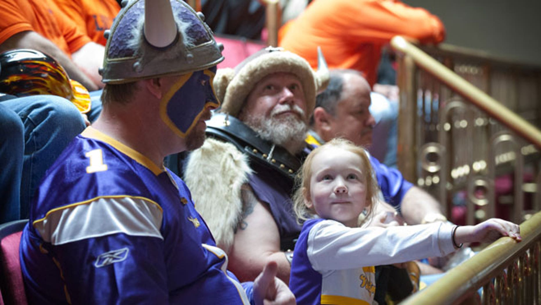"May 8, 2012: Minnesota Vikings fan Hannah Walsh, 5, sits between ""Skolt,"" left, also known as Scott Asplund, and Greg Hanson, who goes by Sir Odin, as the state Senate discussed the Vikings stadium bill in St. Paul, Minn."