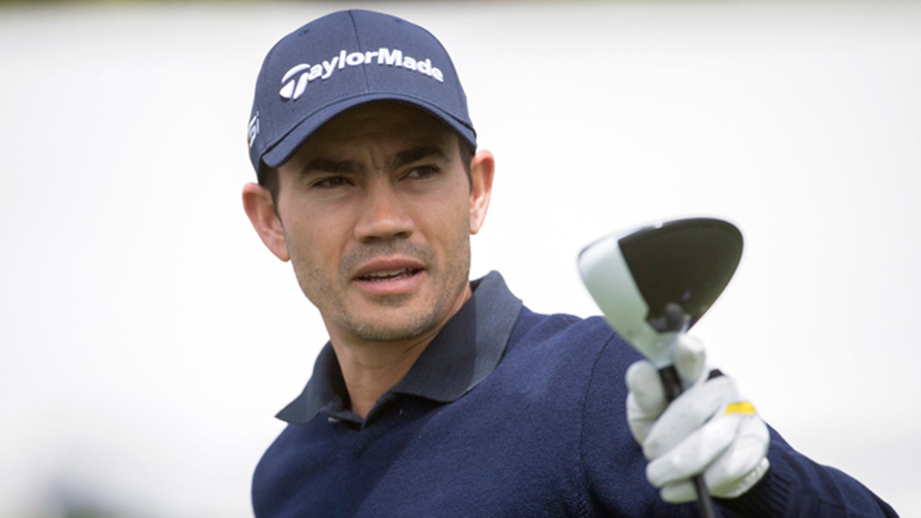 FILE - In this April 14, 2016, file photo, Camilo Villegas, of Colombia, prepares to tee off on the first hole during the first round of the RBC Heritage golf tournament in Hilton Head Island, S.C.  Villegas has pulled out of the Olympics because he is trying to keep his job on the PGA Tour. Villegas had indicated for the last two weeks that he wanted to be in Rio for golf's return to the Olympic program for the first time since 1904. But he is No. 146 in the FedEx Cup with only four tournaments remaining to get into the top 125 and keep full status on the tour. (AP Photo/Stephen B. Morton, File)