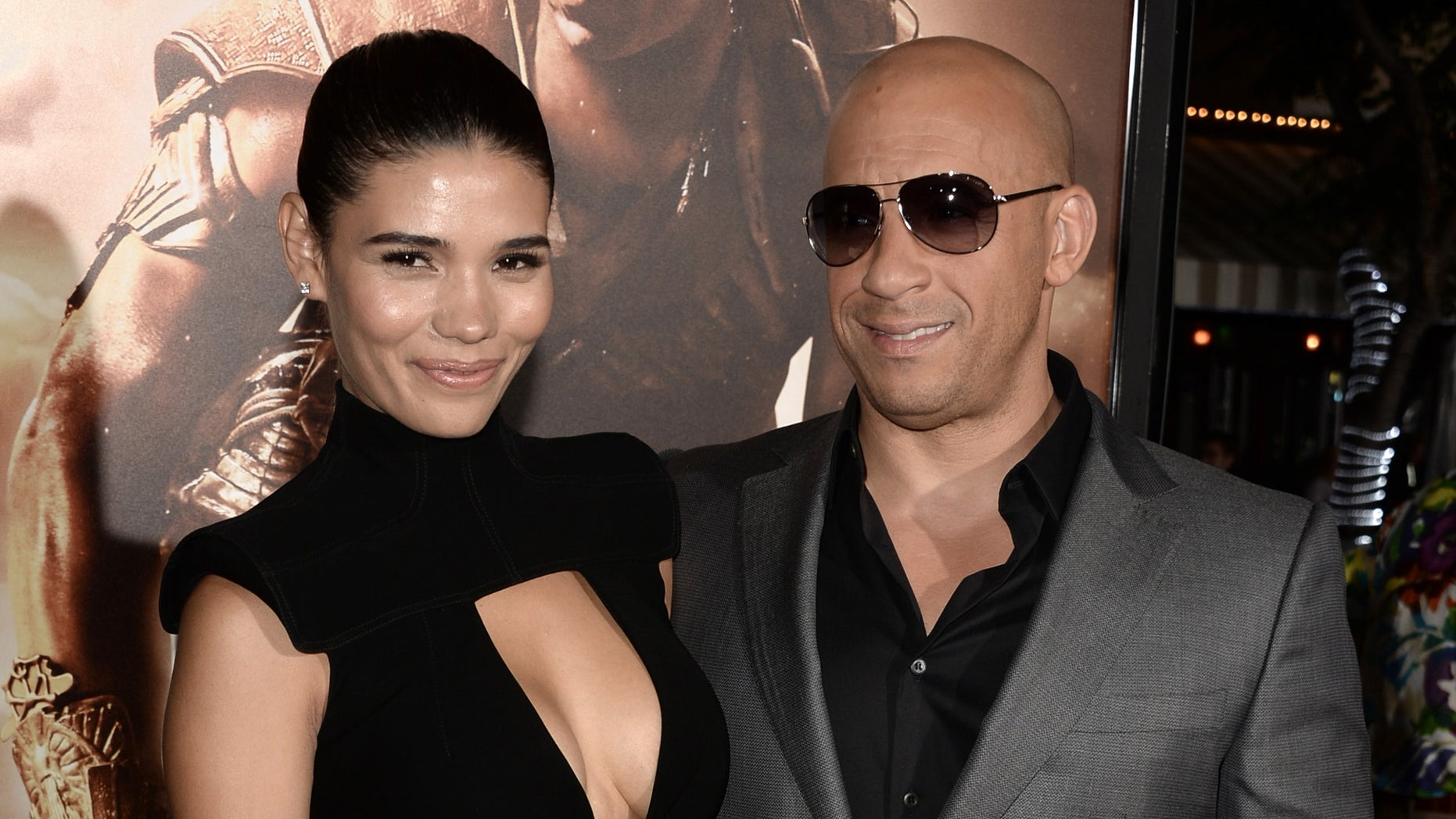 "WESTWOOD, CA - AUGUST 28:  Actor Vin Diesel (R) and model Paloma Jimenez attend the premiere of Universal Pictures' ""Riddick"" at Mann Village Theatre on August 28, 2013 in Westwood, California.  (Photo by Kevin Winter/Getty Images)"