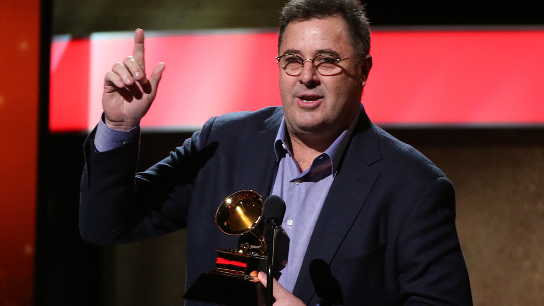"Vince Gill accepts the Grammy for American Roots Song for ""Kid Sister"" at the 59th Annual Grammy Awards in Los Angeles, California, U.S. , February 12, 2017."