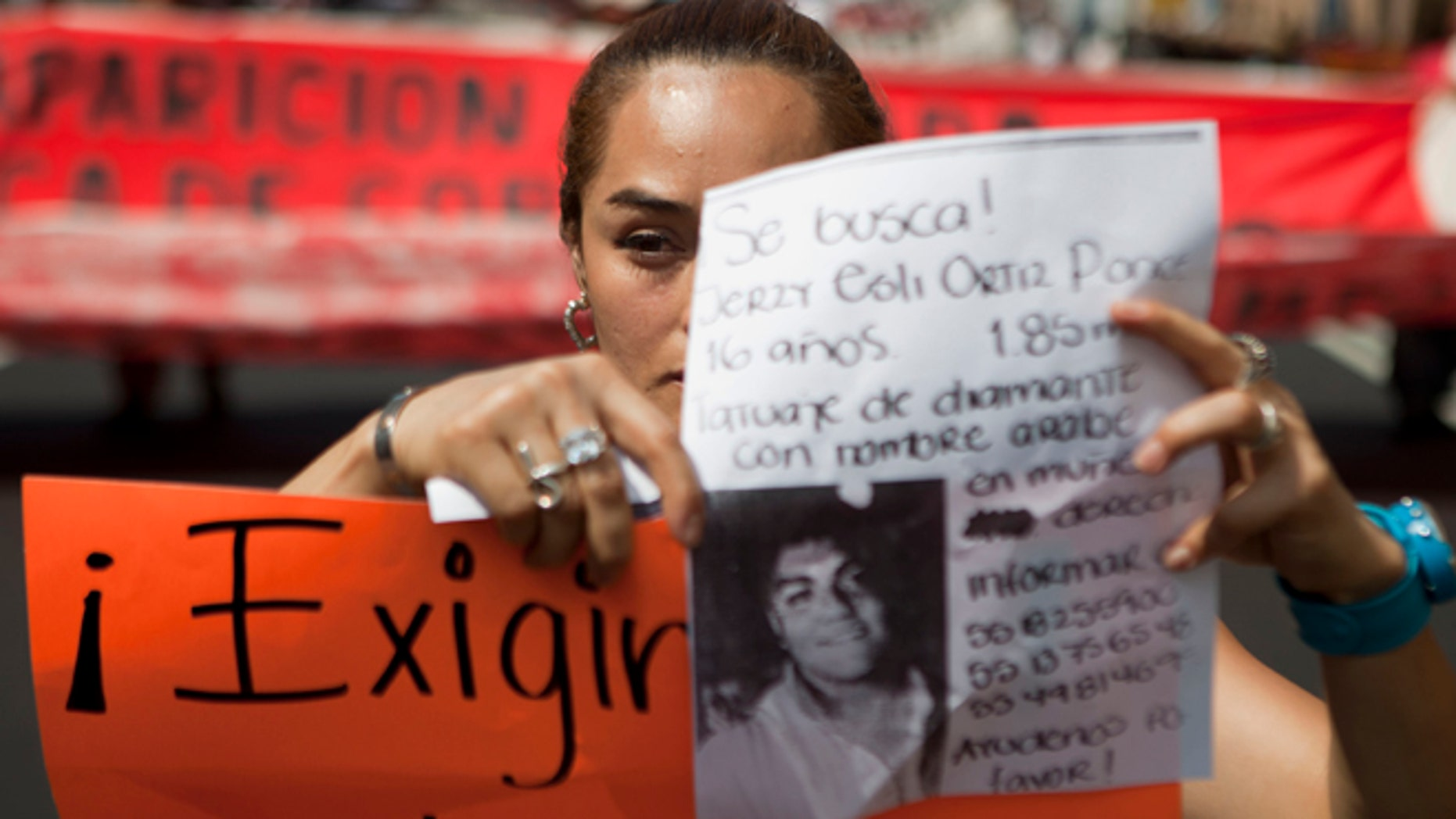 May 30: A woman holds up a sign with details of her recently disappeared relative during a protest in Mexico City.