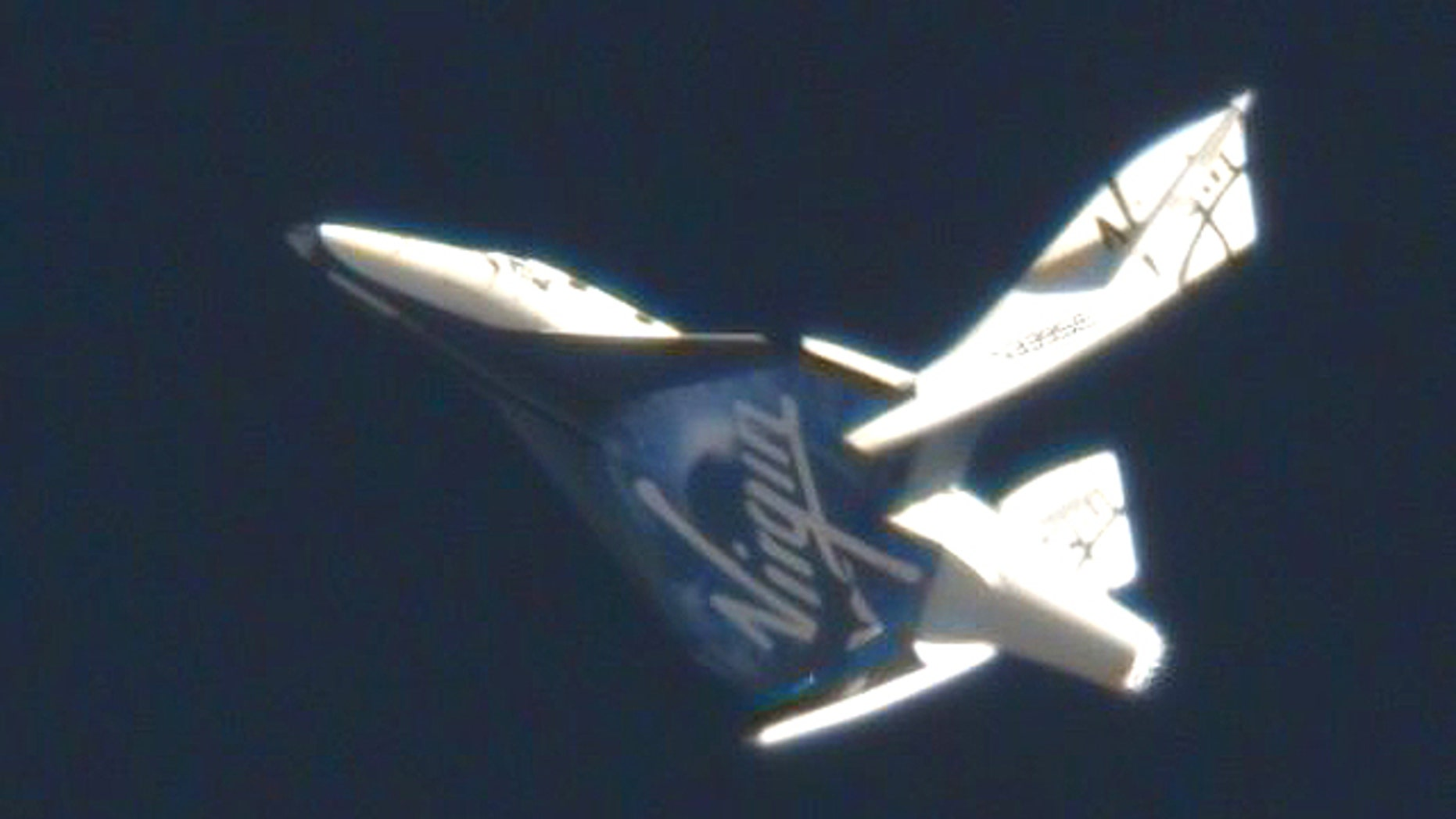 """Virgin's VSS Enterprise falls back to Earth, completing a test known as """"feathering."""""""