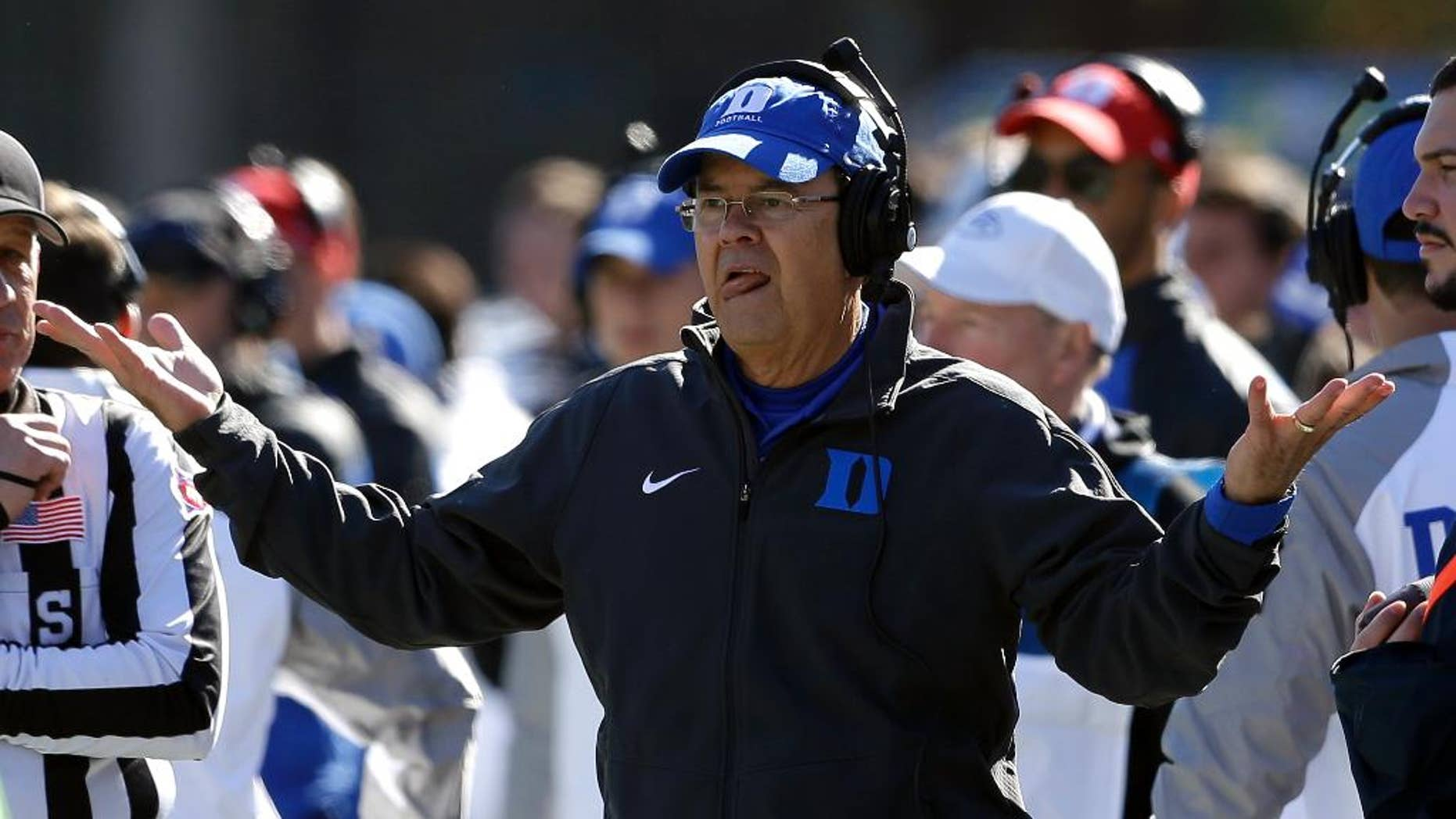 Duke coach David Cutcliffe reacts during the first half of an NCAA college football game against Virginia Tech in Durham, N.C., Saturday, Nov. 15, 2014. Virginia Tech won 17-16. (AP Photo/Gerry Broome)