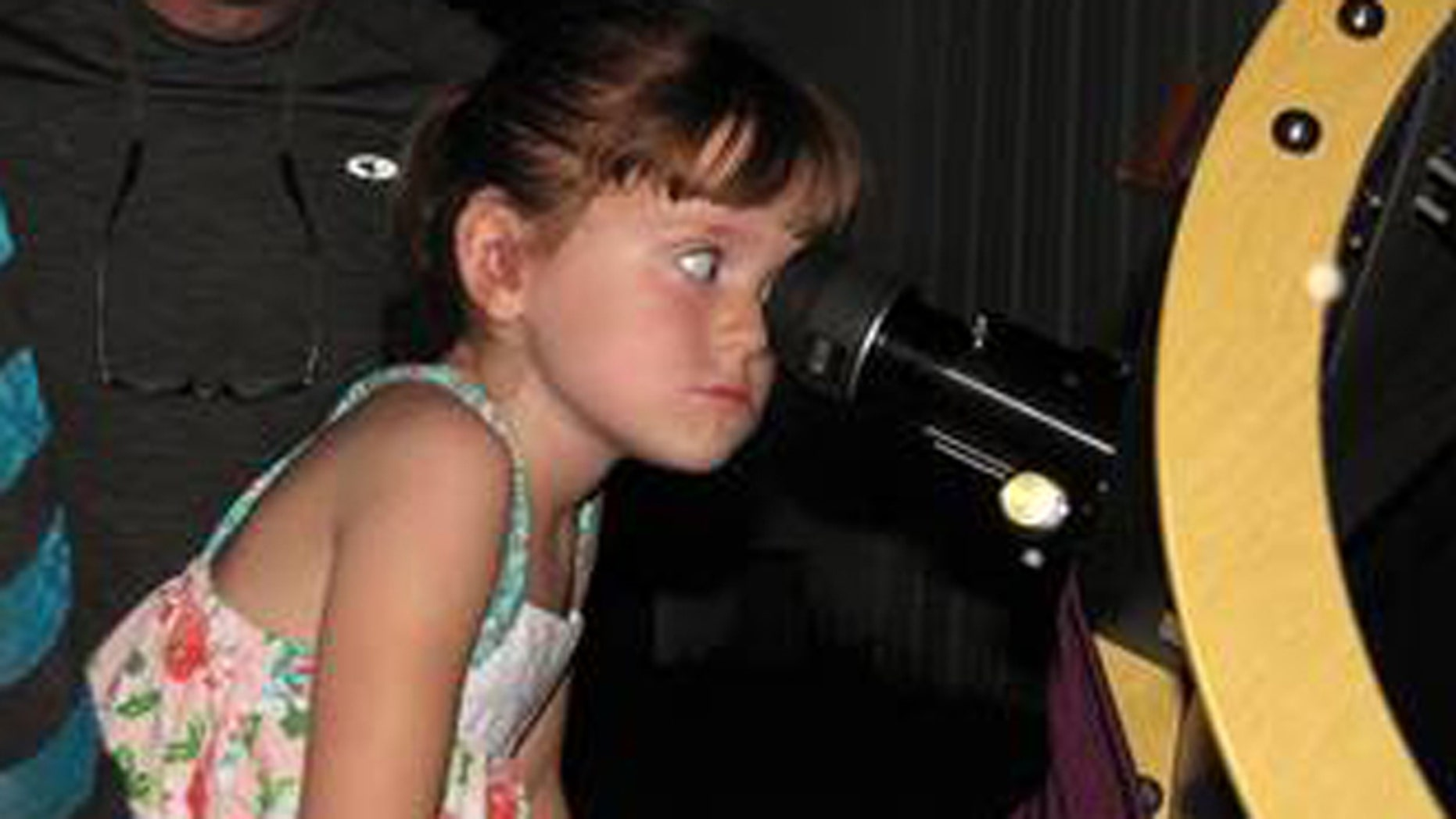"July 28, 2015: In this July 28, 2015, photo, Elizabeth ""Lizzy"" Myers, 5, gazes through a telescope at the Warren Rupp Observatory in Bellville, Ohio."