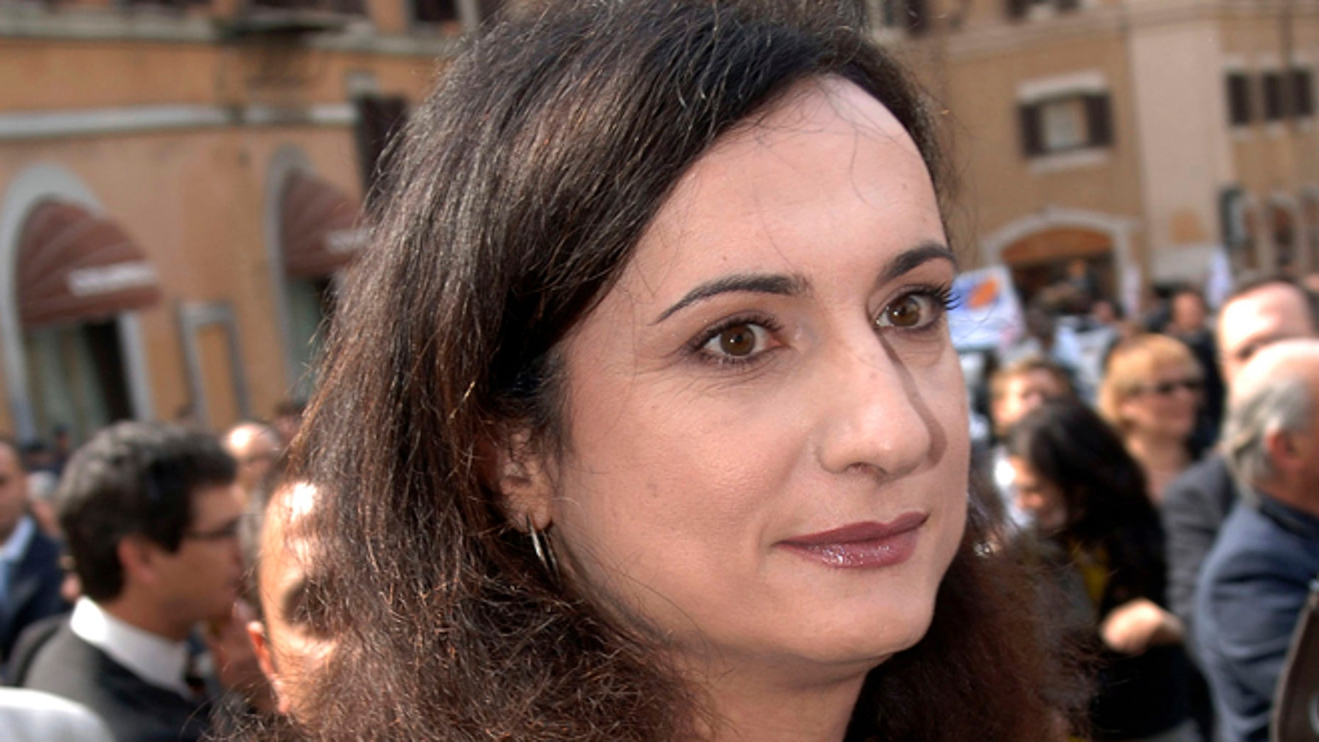 """April 28, 2006: In this file photo, then Italian Communist Refoundation Party lawmaker Vladimir Luxuria, Italy's first transgender lawmaker, arrives at the Lower Chamber in Rome. Italian Daily Corriere della Sera quoted an Italian advocate for gay rights, Imma Battaglia, as saying Luxuria called to say she was arrested by police in Sochi while attending the 2014 Games with a flag with the slogan, in Russian, """"Gay is OK."""""""