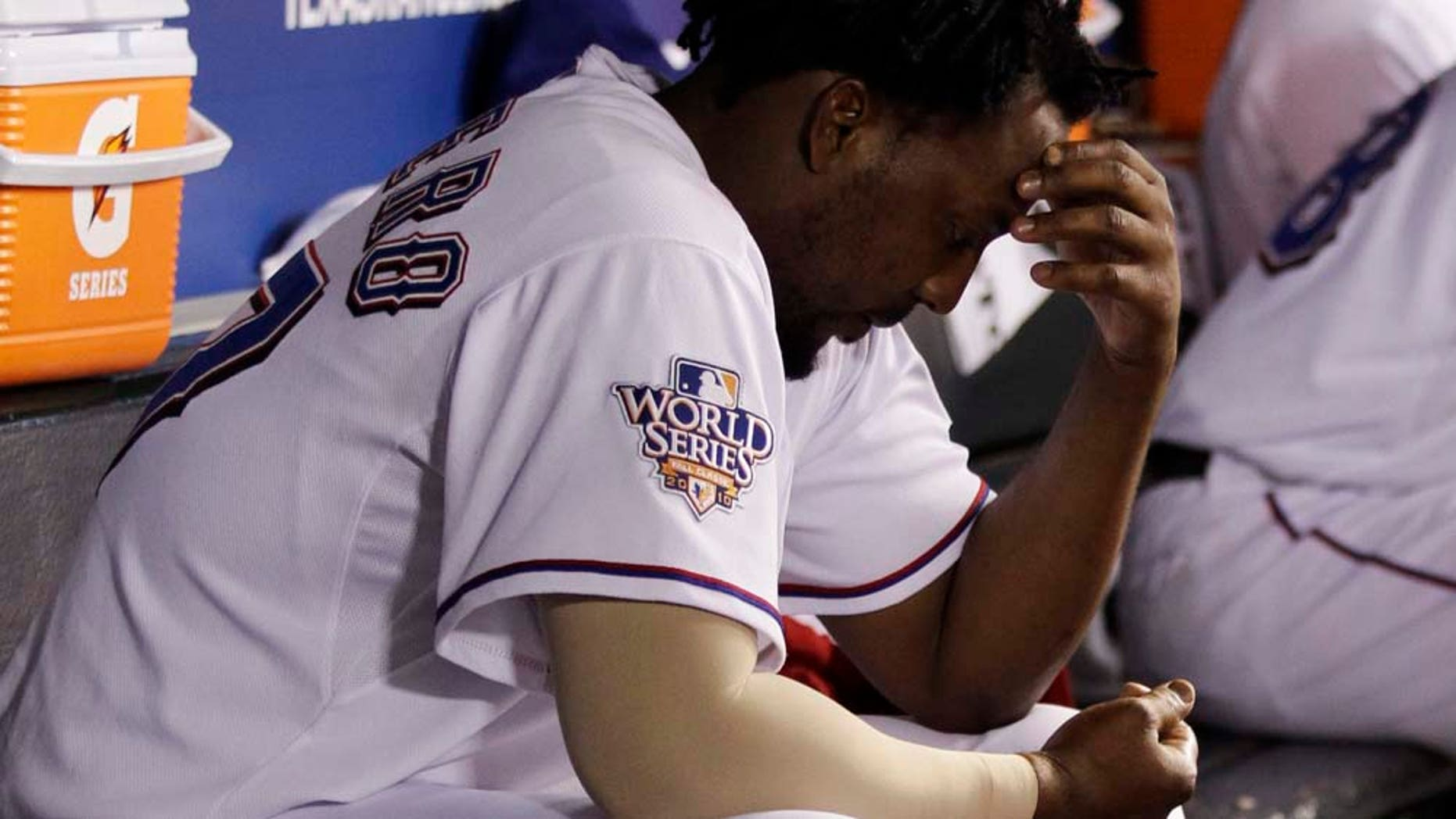 Texas Rangers' Vladimir Guerrero sits in the dugout after striking out during the seventh inning of Game 4 of baseball's World Series against the San Francisco Giants Sunday, Oct. 31, 2010, in Arlington, Texas. (AP Photo/David J. Phillip)