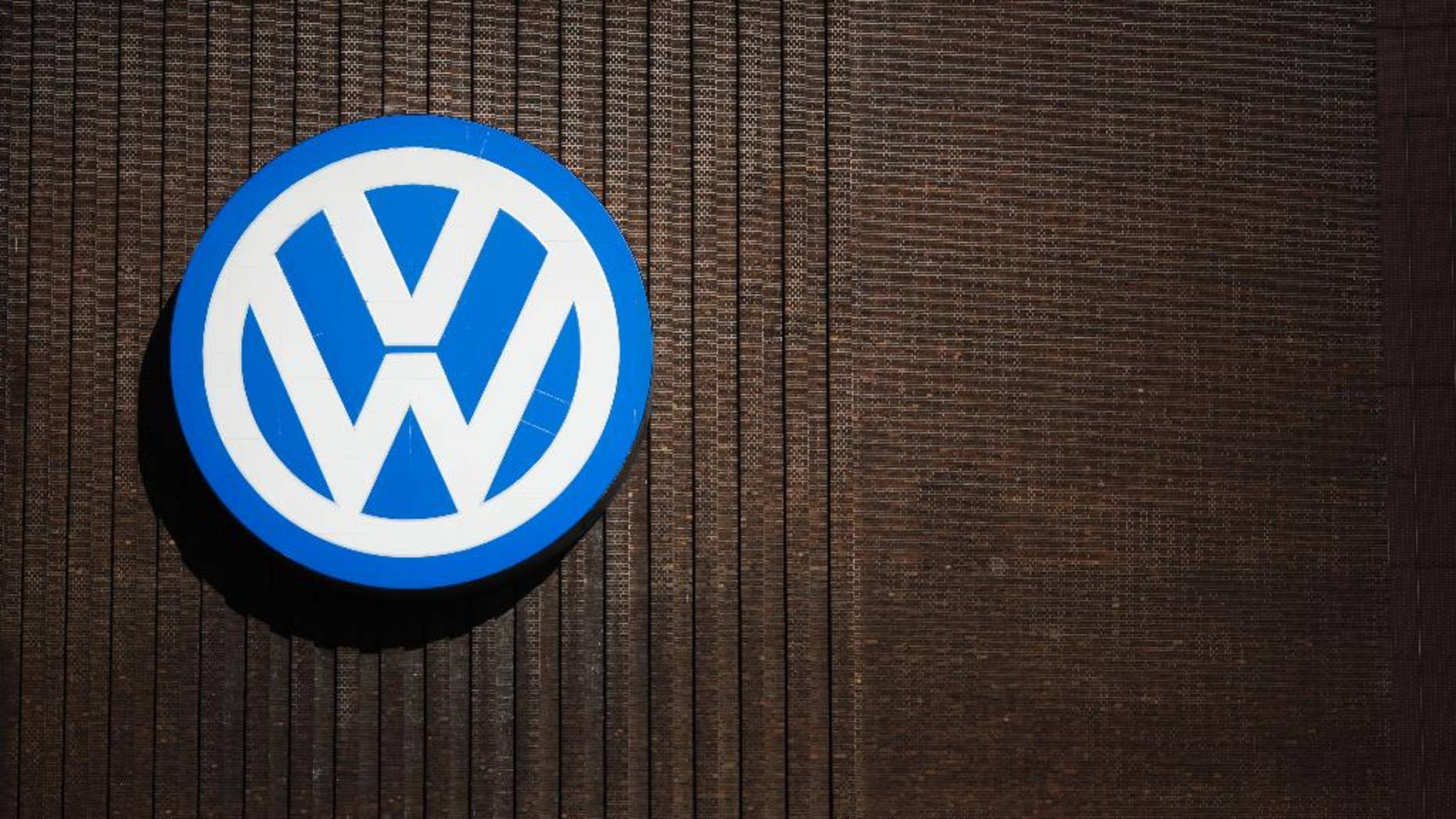FILE - In this Sept. 29, 2015, file photo, a brand sign of the Volkswagen car company is seen at the car factory in Wolfsburg, Germany. More than a decade ago, the U.S. Environmental Protection Agency helped develop a technology that ultimately allowed an independent laboratory to catch Volkswagen's elaborate cheating on car emissions tests. But EPA did not apply that technology on its own tests of diesel passenger cars and instead focused on trucks,thus missing its best chance to foil the German carmaker's deception as early as 2007. (AP Photo/Markus Schreiber, File)