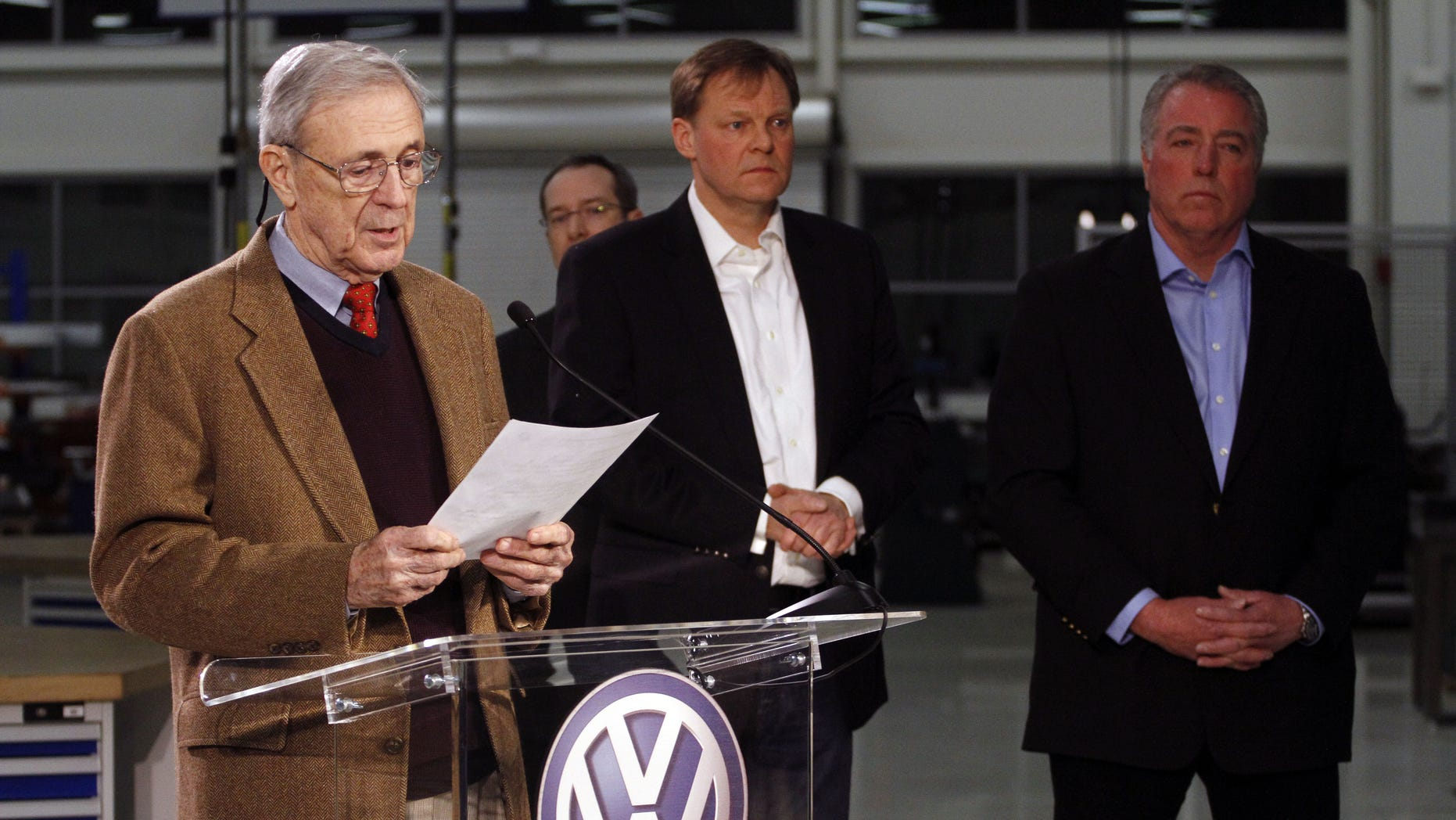 Retired circuit judge Sam Payne, left, announces that Volkswagen employees voted to deny representation by the United Auto Workers union as Frank Fischer, Chairman and CEO of the Volkswagen Group of America, center, and Gary Casteel, UAW Region 8 Director, look on from behind, concluding a three day election which ended this evening Friday, Feb. 14, 2014, in Chattanooga, Tenn. (AP Photo/Chattanooga Times Free Press, Dan Henry) THE DAILY CITIZEN OUT; NOOGA.COM OUT; CLEVELAND DAILY BANNER OUT; LOCAL INTERNET OUT