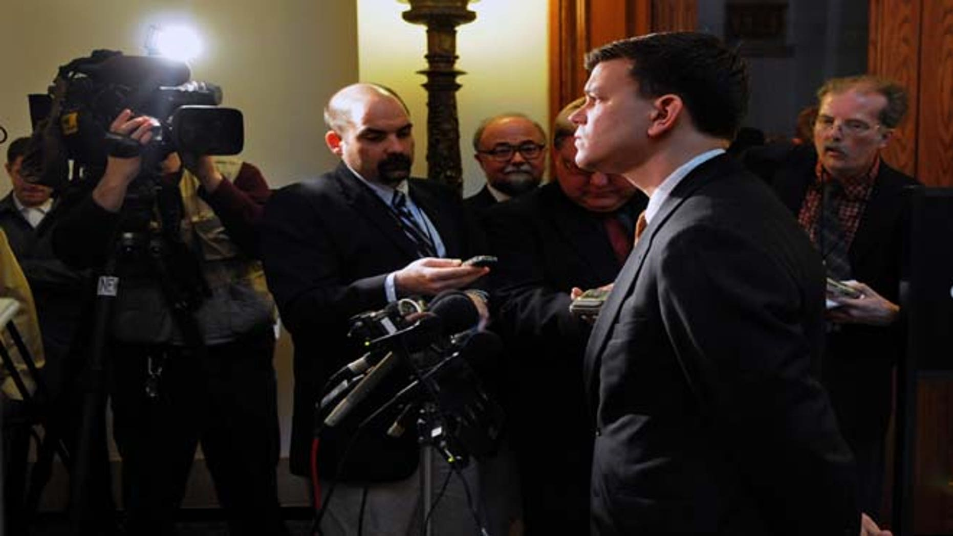 """In this March 15, 2010, file photo Minnesota Rep. Ryan Winkler, D-Golden Valley, talks to the press in St Paul, Minn. Winkler apologized swiftly Tuesday, June 25, 2013, for a tweet he sent that referred to Supreme Court Justice Clarence Thomas as """"Uncle Thomas"""" following a major ruling on the nation's landmark voting rights law."""