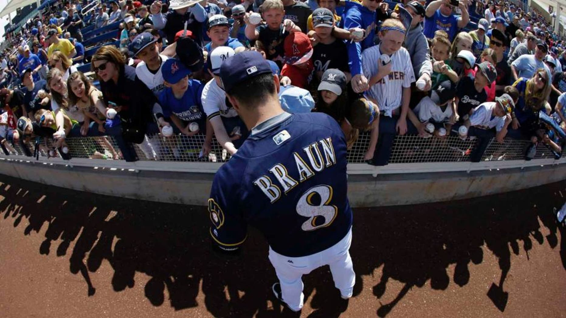 Tuesday, March 29: In this image taken with a fisheye lens, the Milwaukee Brewers' Ryan Braun signs autographs for fans before a spring training game against the Cincinnati Reds in Phoenix.