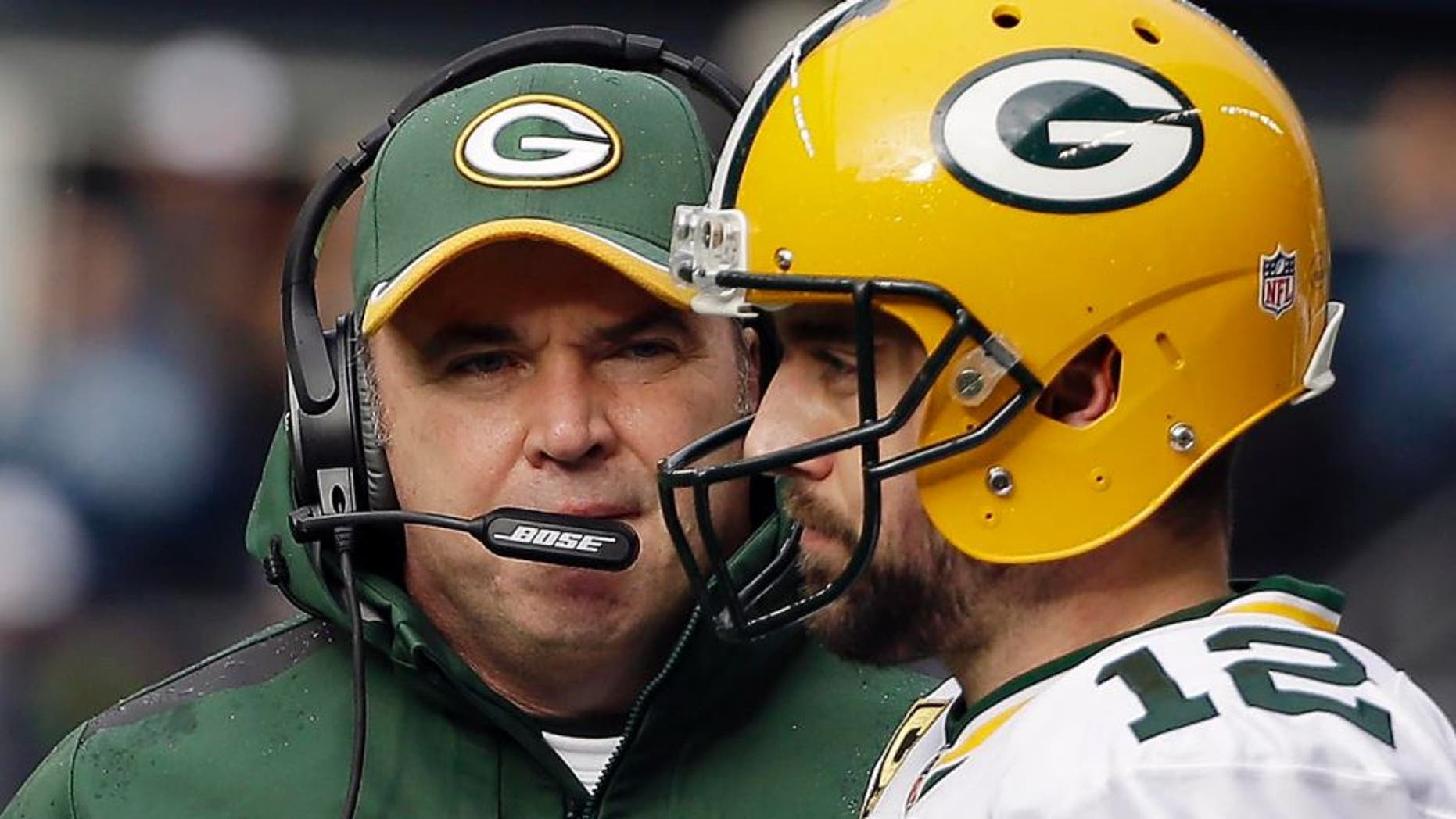 Sunday, January 18: Green Bay Packers head coach Mike McCarthy (left) talks to quarterback Aaron Rodgers during the first half of the NFC championship game in Seattle.